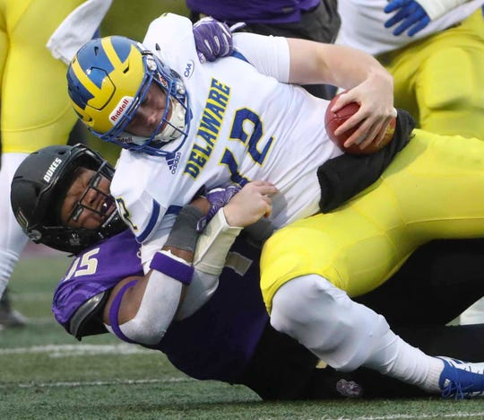 Delaware quarterback Pat Kehoe is sacked by James Madison's Paris Black in the second quarter at Bridgeforth Stadium during the opening round of the NCAA FCS playoffs Saturday.