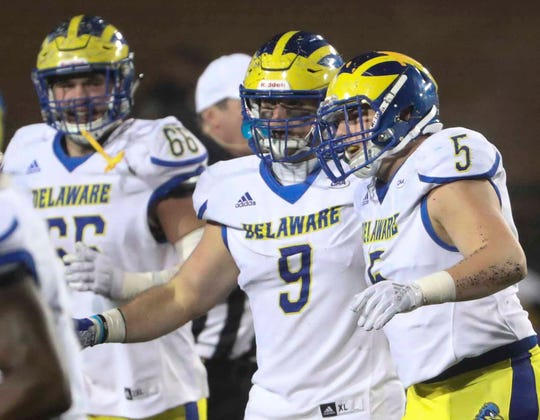 Delaware's Troy Reeder (9) celebrates with Charles Bell after Bell's fumble recovery in the third quarter of the Blue Hens' 20-6 loss at Bridgeforth Stadium during the opening round of the NCAA FCS playoffs in 2018.