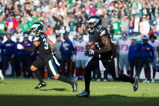 Eagles' Malcolm Jenkins (27) looks for space after interception New York's Eli Manning right before halftime Sunday at Lincoln Financial Field.