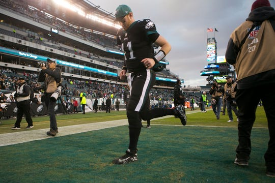 Eagles' Carson Wentz (11) heads into the locker room after leading the Eagles to a 25-22 win over the Giants on Nov. 25 at Lincoln Financial Field.