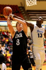 Rider's Ben Moffat is fouled by Brewer's Jahrad Taylor  Saturday night at DL Ligon Coliseum as the Rider Raiders fell 45-42 in overtime to the Brewer Bears in the Fantasy of Lights Basketball Tournament large school championship game.  Moffat had 15 points, eight rebounds and four blocks.