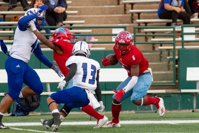 Hirschi running back Daimarqua Foste searches for an opening against the San Angelo Lake View defense during the Huskies' 55-23 victory Saturday at Shotwell Stadium in Abilene.