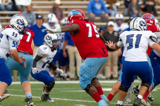 Hirschi offensive tackle Johnny Taylor looks to make his block Saturday during the Huskies' 55-23 victory against San Angelo Lake View at Shotwell Stadium in Abilene.