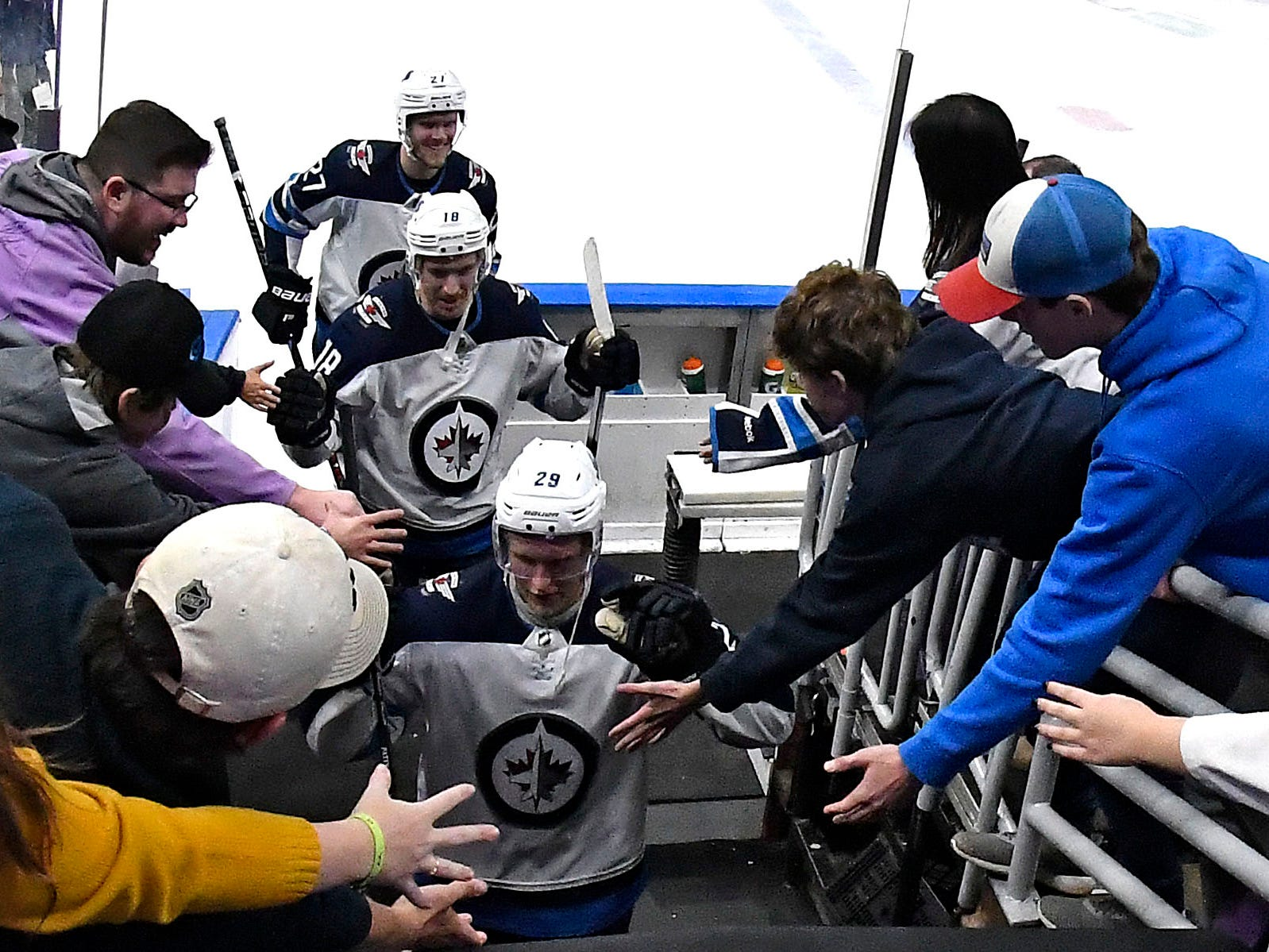 Nov. 24: Winnipeg Jets right wing Patrik Laine (29) is congratulated by fans after he scored five goals in an 8-4 win against the St. Louis Blues.