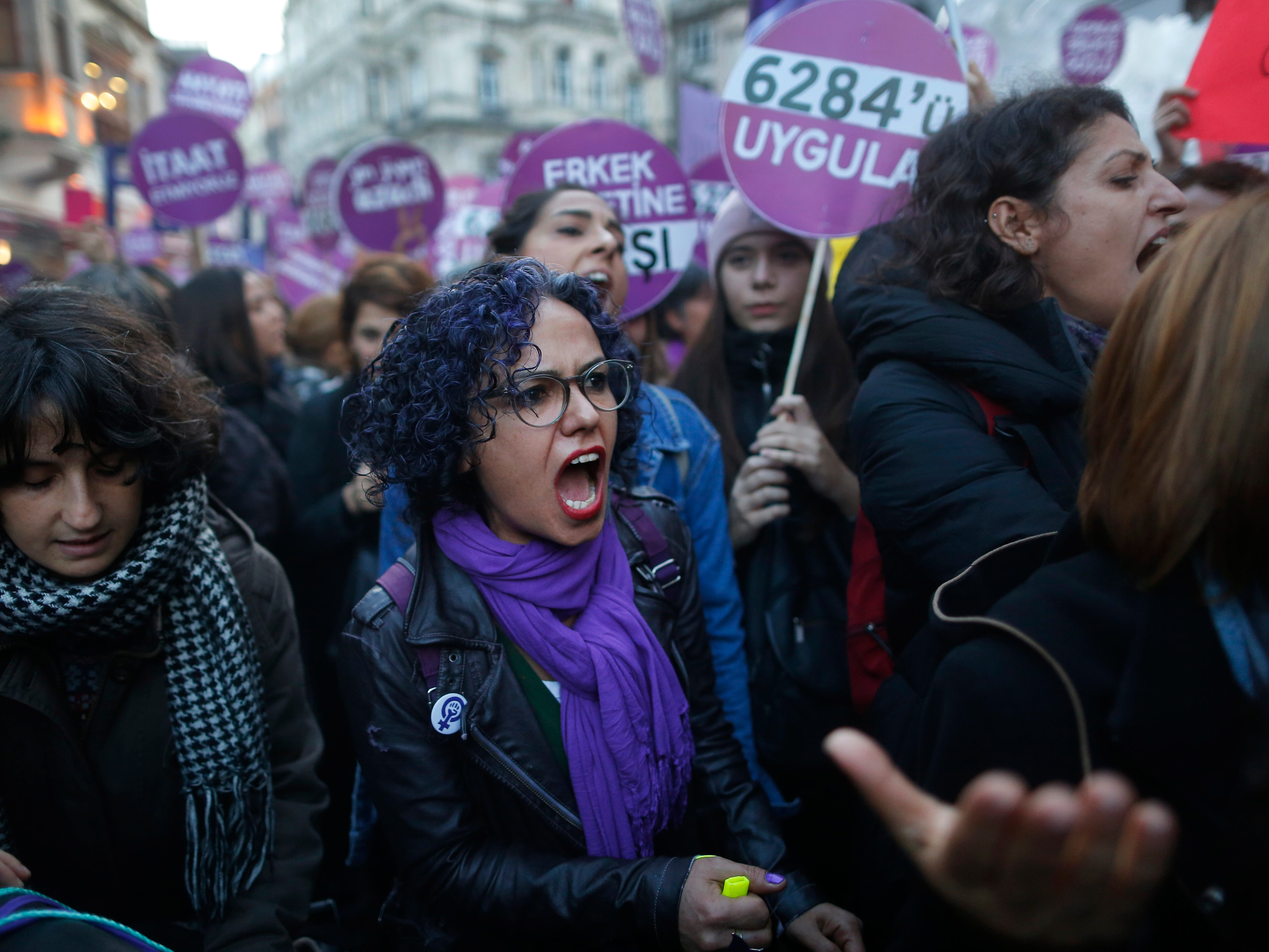 Protesters, mostly women, display placards and chant slogans during a rally in central Istanbul, Sunday, Nov. 25, 2018, to mark the United Nations' International Day for the Elimination of Violence Against Women.