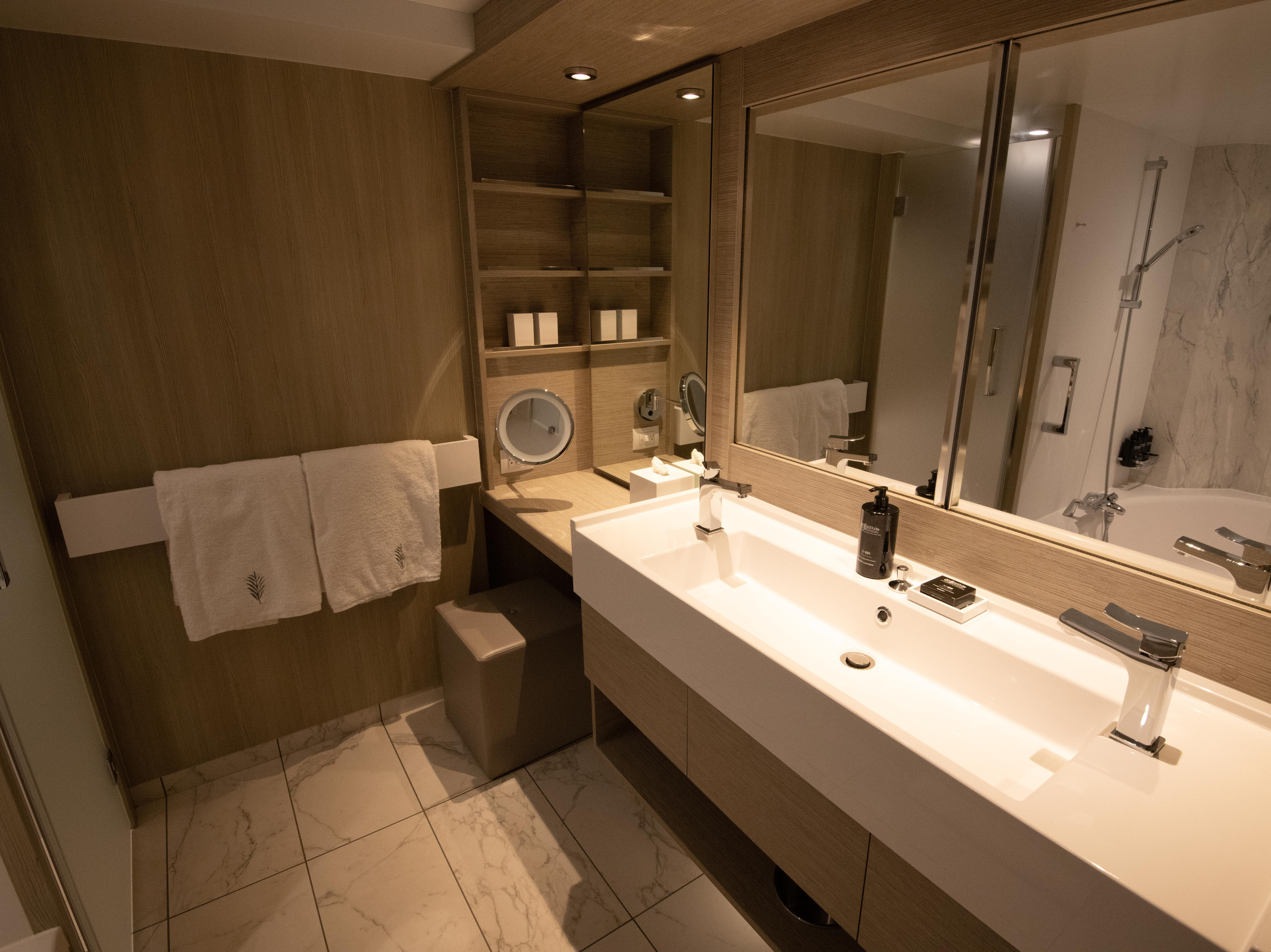 Sky Suites feature generous bathrooms lined with marble.