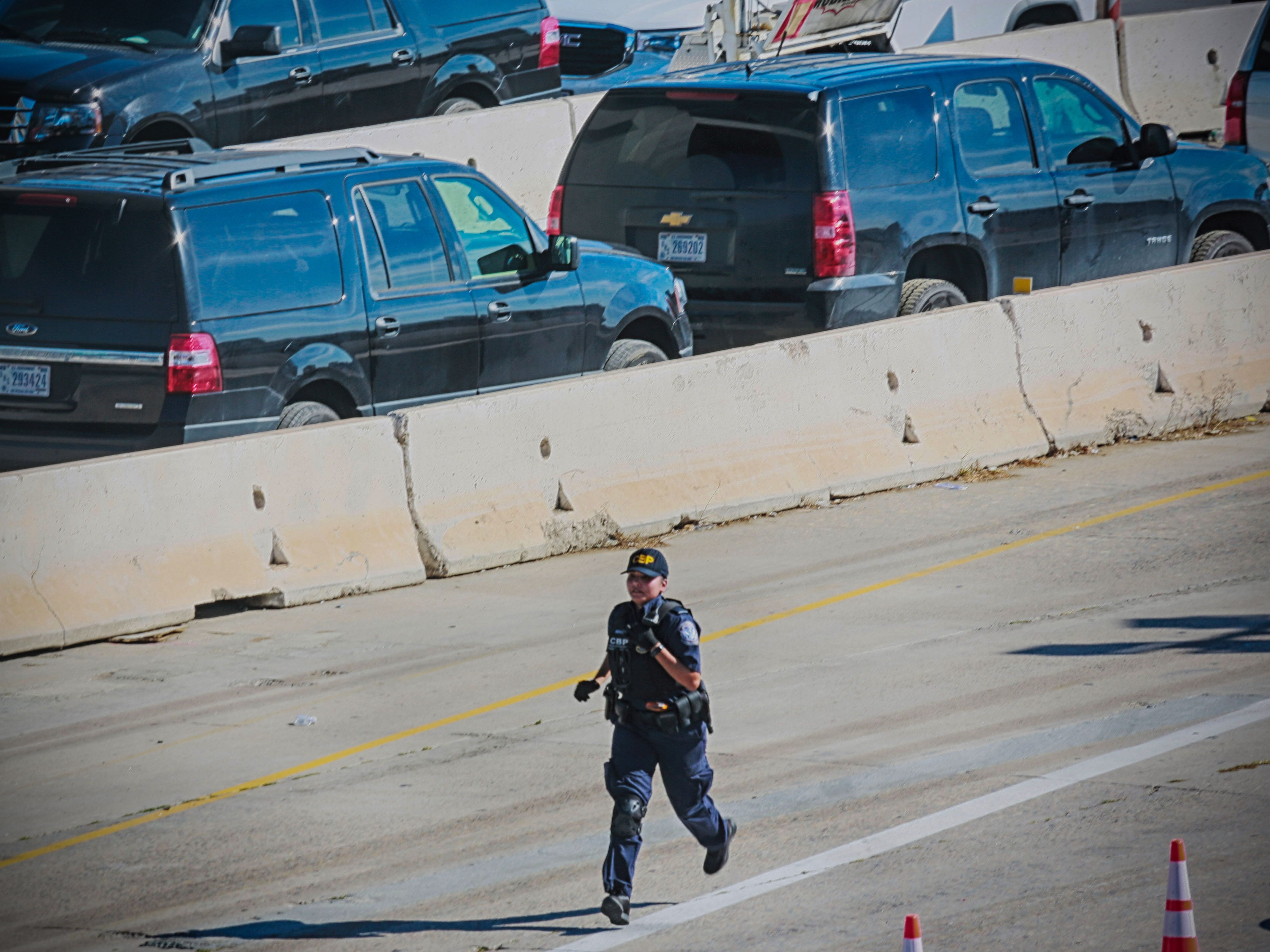 A U.S. Customs and Border Patrol agents is seen running after the closing of the U.S.-Mexico border was ordered on Nov. 25, 2018 at the San Ysidro border crossing point south of San Diego. U.S. officials closed a border crossing in southern California on Sunday after hundreds of migrants tried to breach a border fence from the Mexican city of Tijuana. The U.S. Customs and Border Protection office in San Diego, California, said on Twitter that it had closed both north and south access to vehicle traffic at the San Ysidro border post, before also suspending pedestrian crossings.
