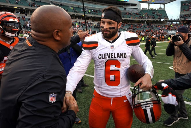 Browns quarterback Baker Mayfield, right, chats with former head coach Hue Jackson after Sunday's 35-20 victory over the Bengals. Jackson is now a special assistant on the Bengals coaching staff.