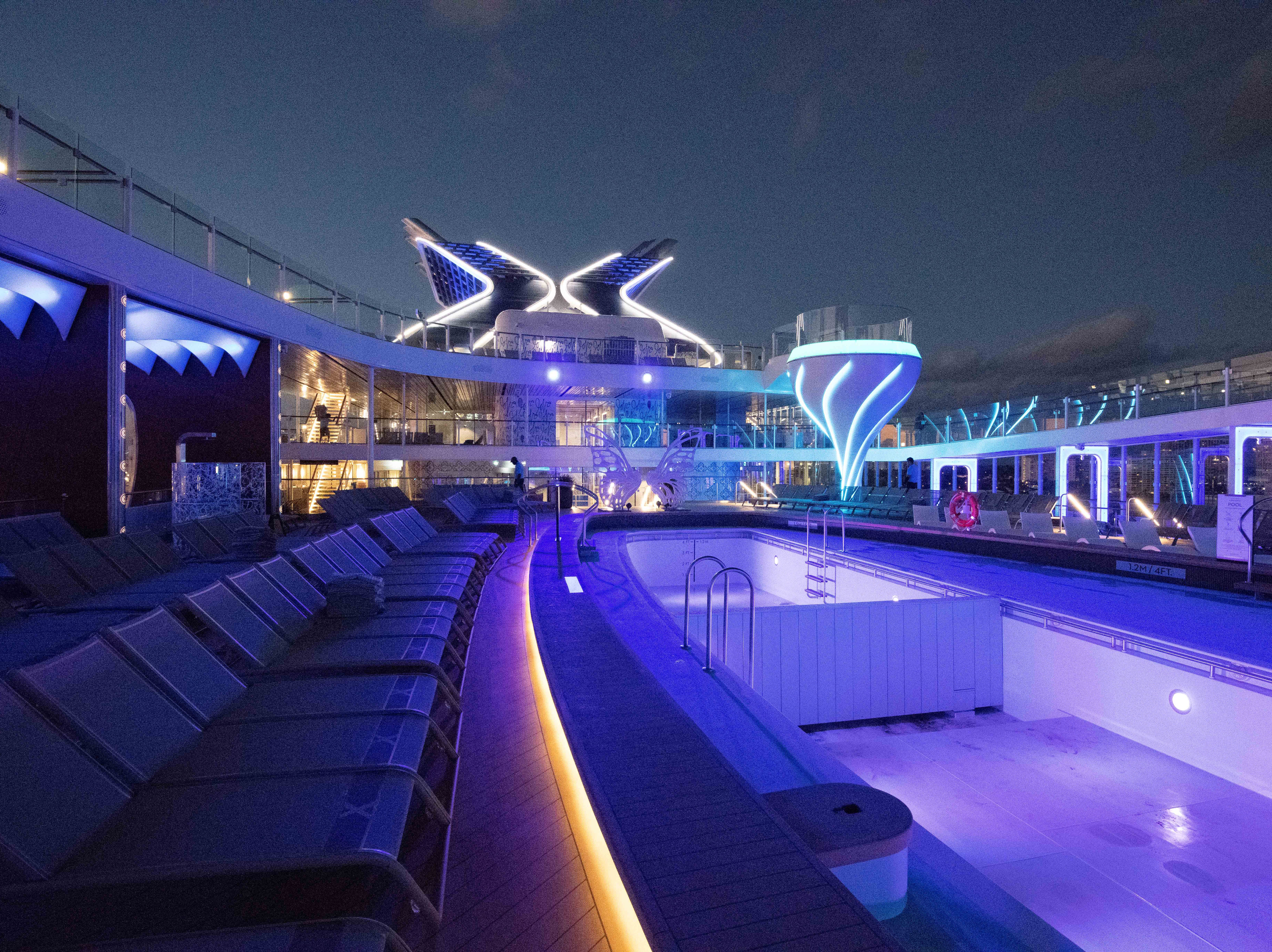 The celebrity Edge pool deck at night.