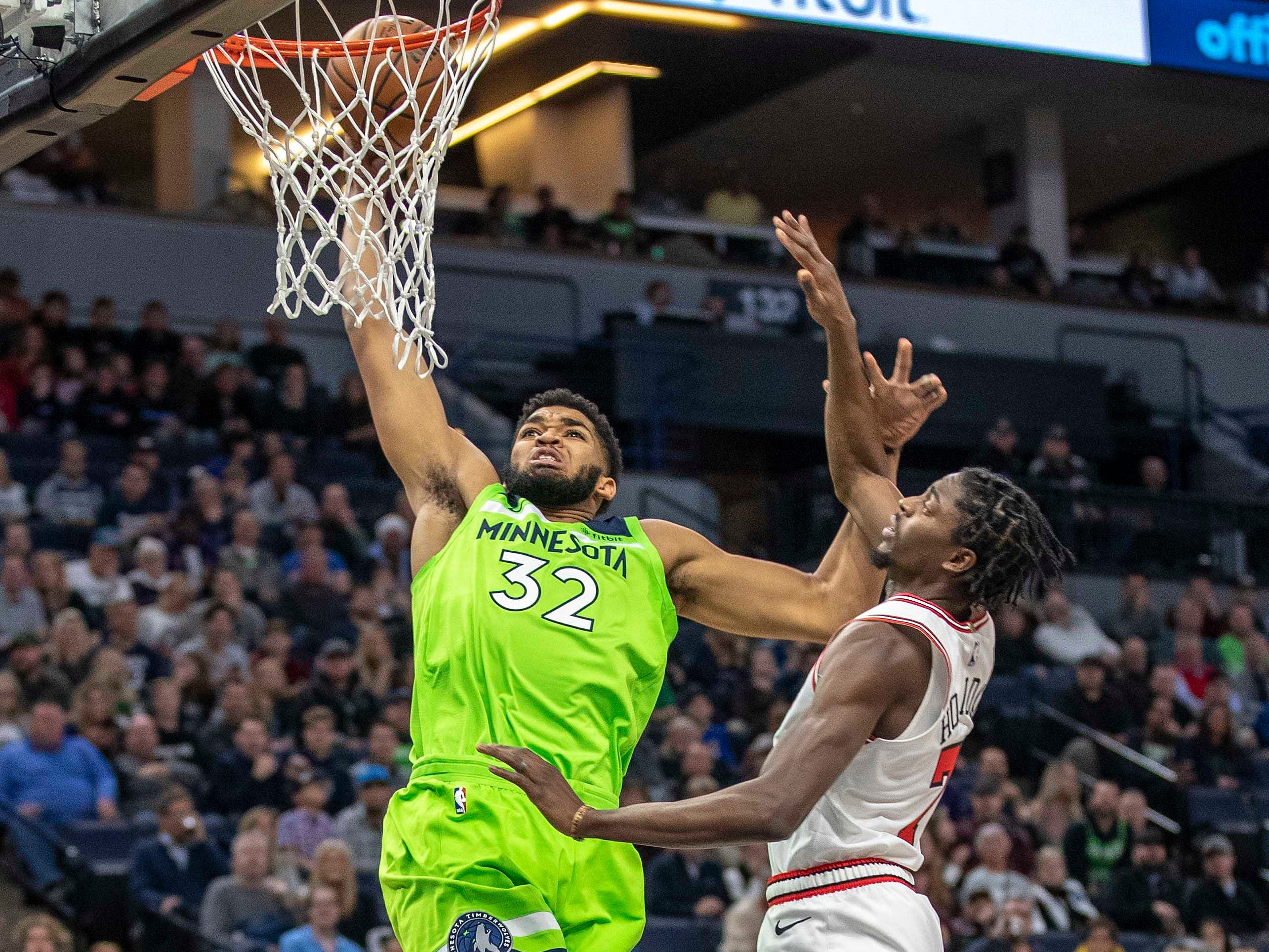Nov. 24: Timberwolves center Karl-Anthony Towns (32) rises up for a one-handed slam over Bulls defender Justin Holiday (7).