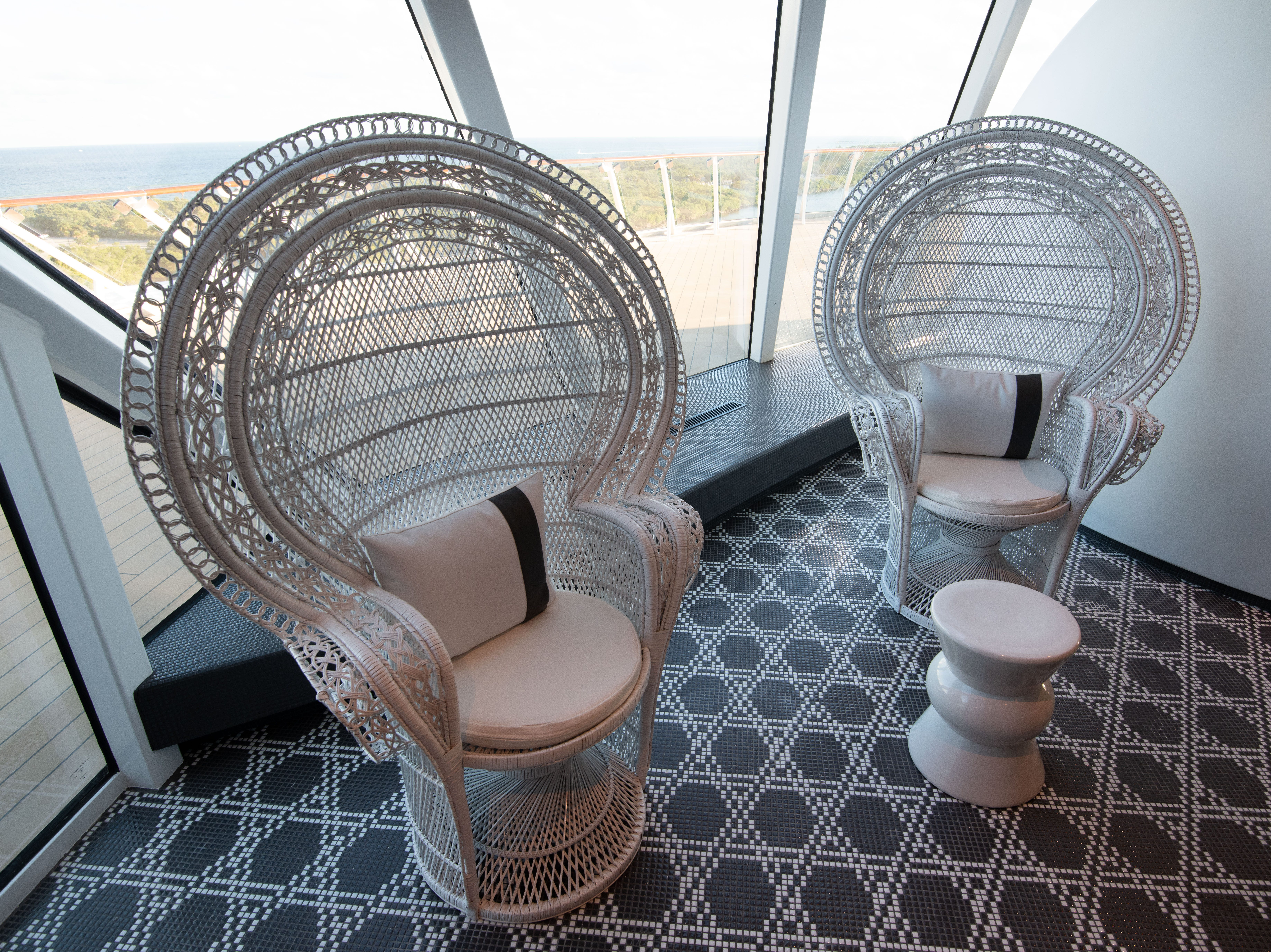Stylish wicker chairs await passengers at the Celebrity Edge spa's thermal suite complex.