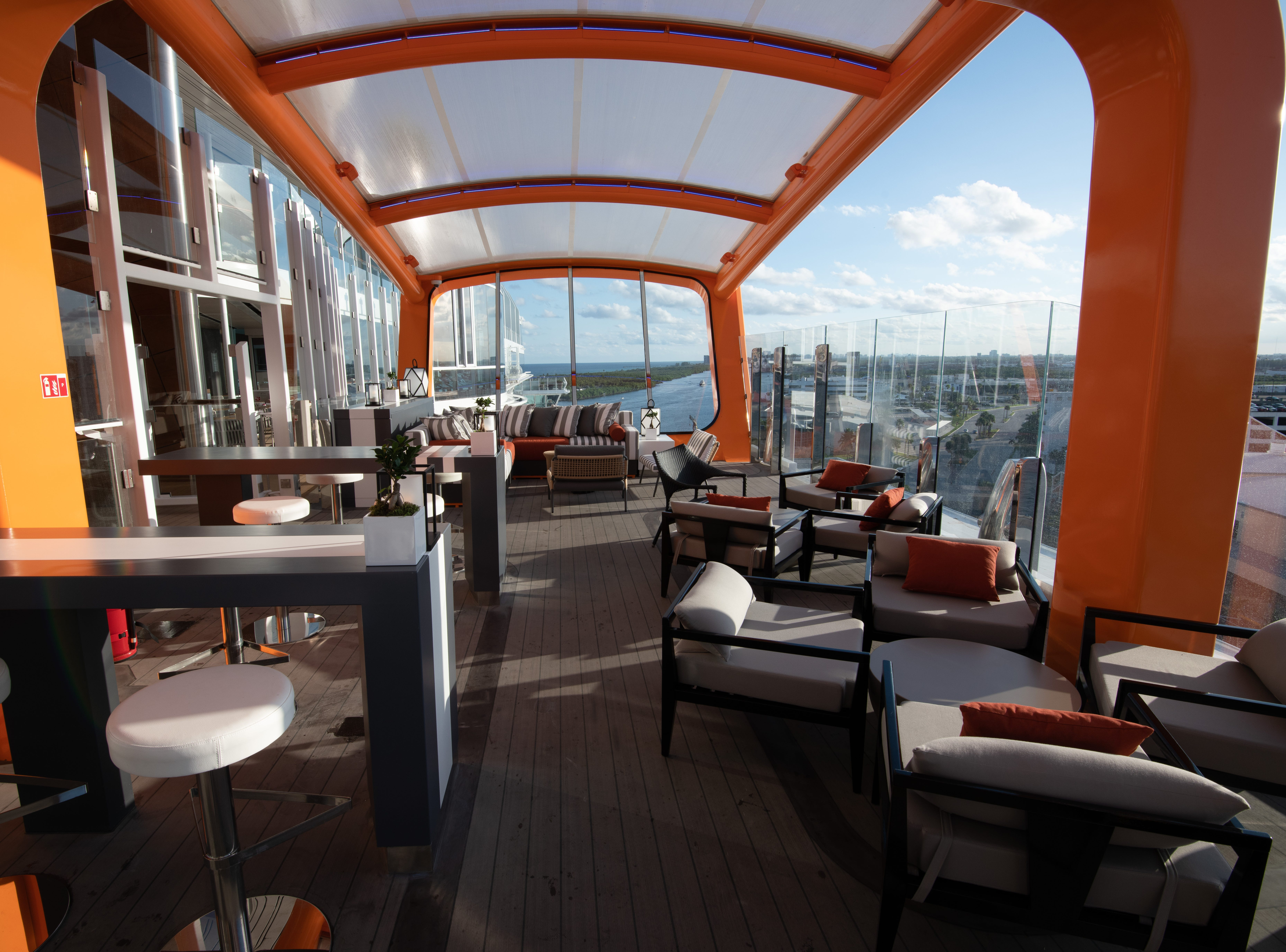 Shown here just off Deck 14, the tangerine-colored Magic Carpet moves up and down the side of Celebrity Edge to serve multiple functions. Among them: A lounge with some of the best views at sea.