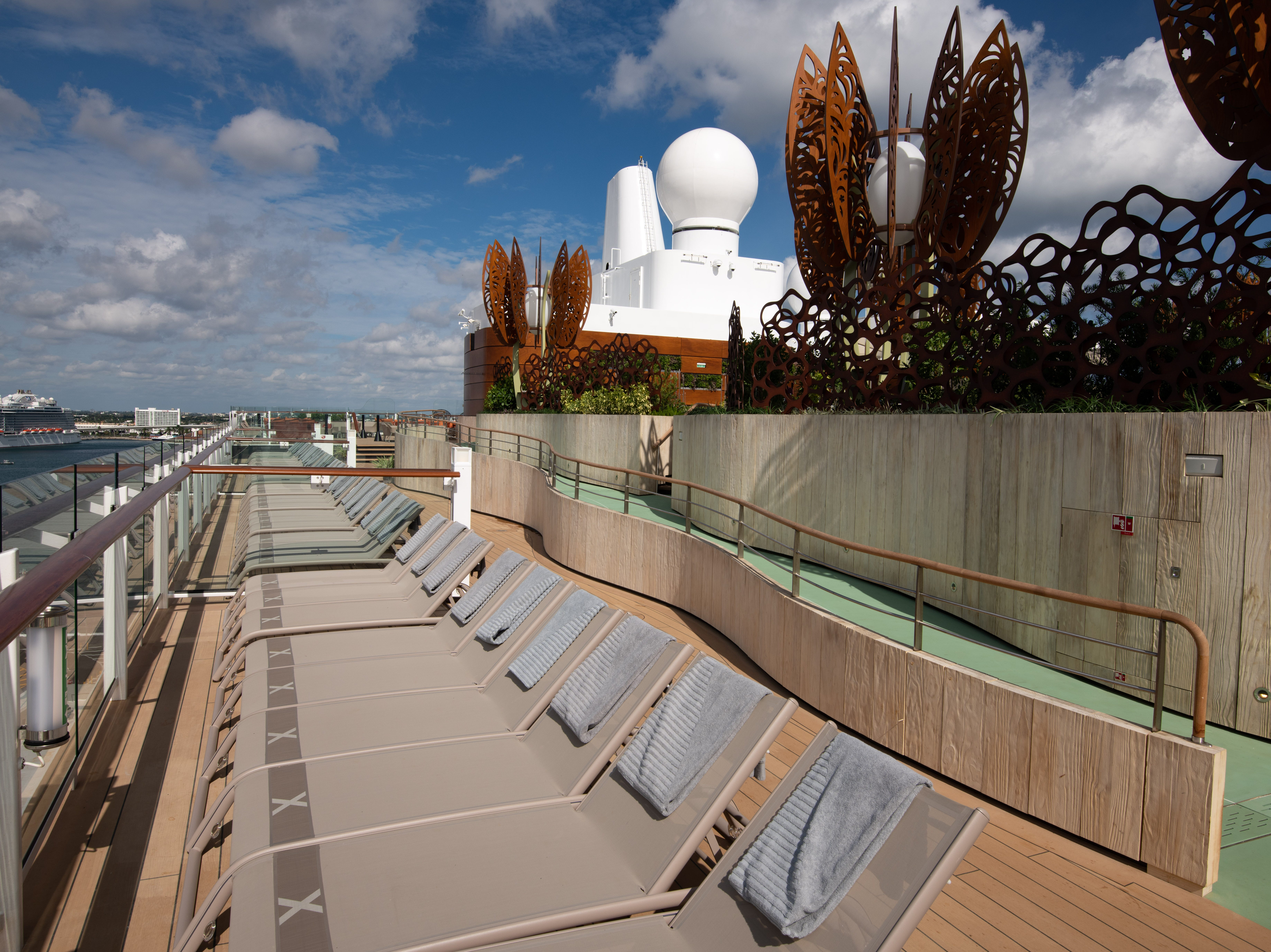 More lounge chairs line the side of Celebrity Edge just outside the Rooftop Garden.