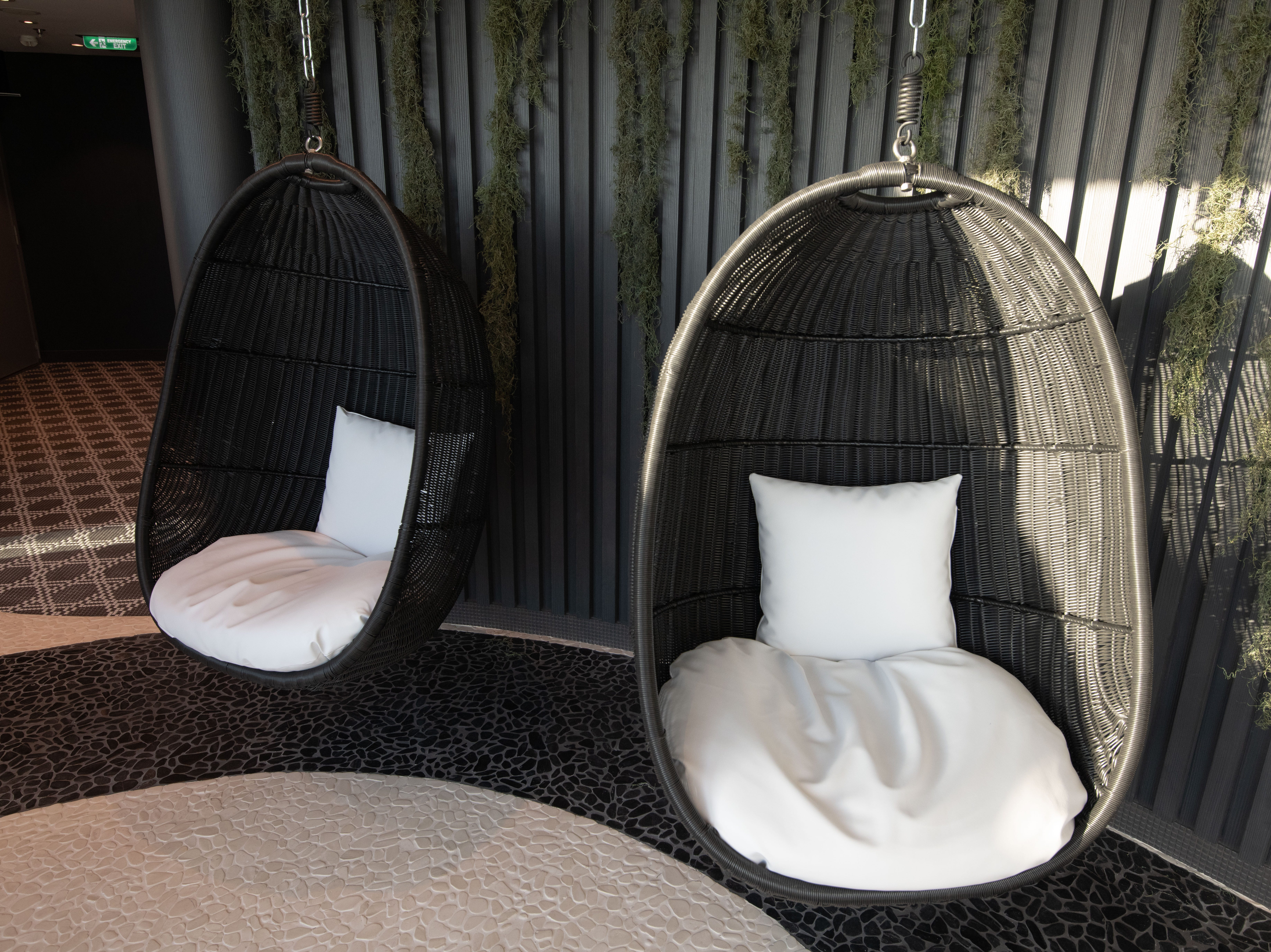 A pair of hanging chairs in the thermal suite within the Celebrity Edge spa.