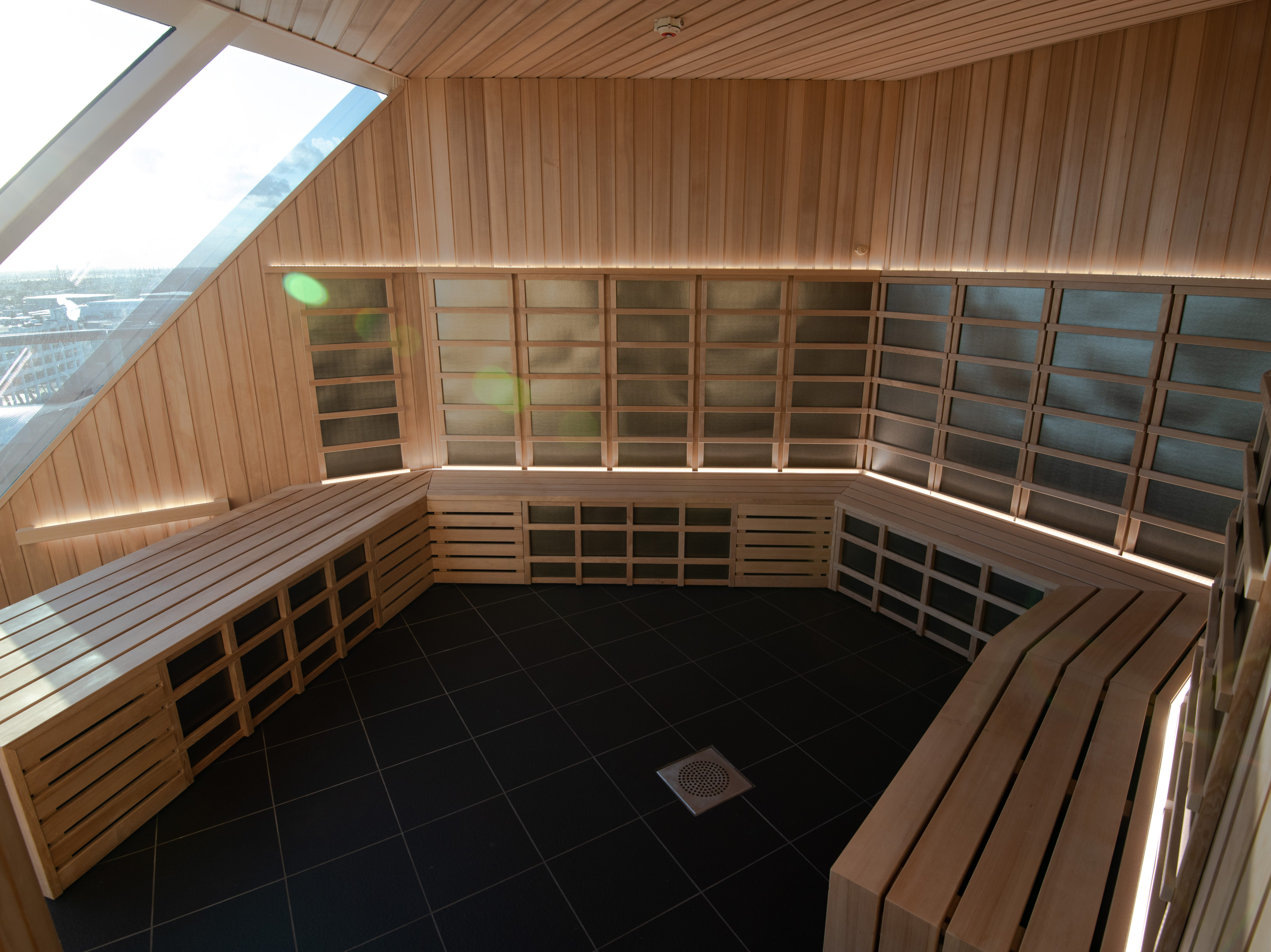 A traditional sauna within the thermal suite  on Celebrity Edge.