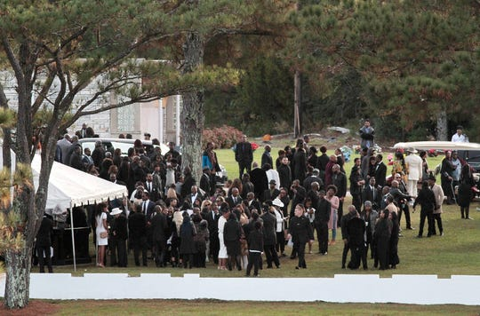 Mourners attend funeral services and interment for former model and actress Kim Porter at Evergreen Memorial Gardens Saturday, Nov. 24, 2018, in Columbus, Ga.