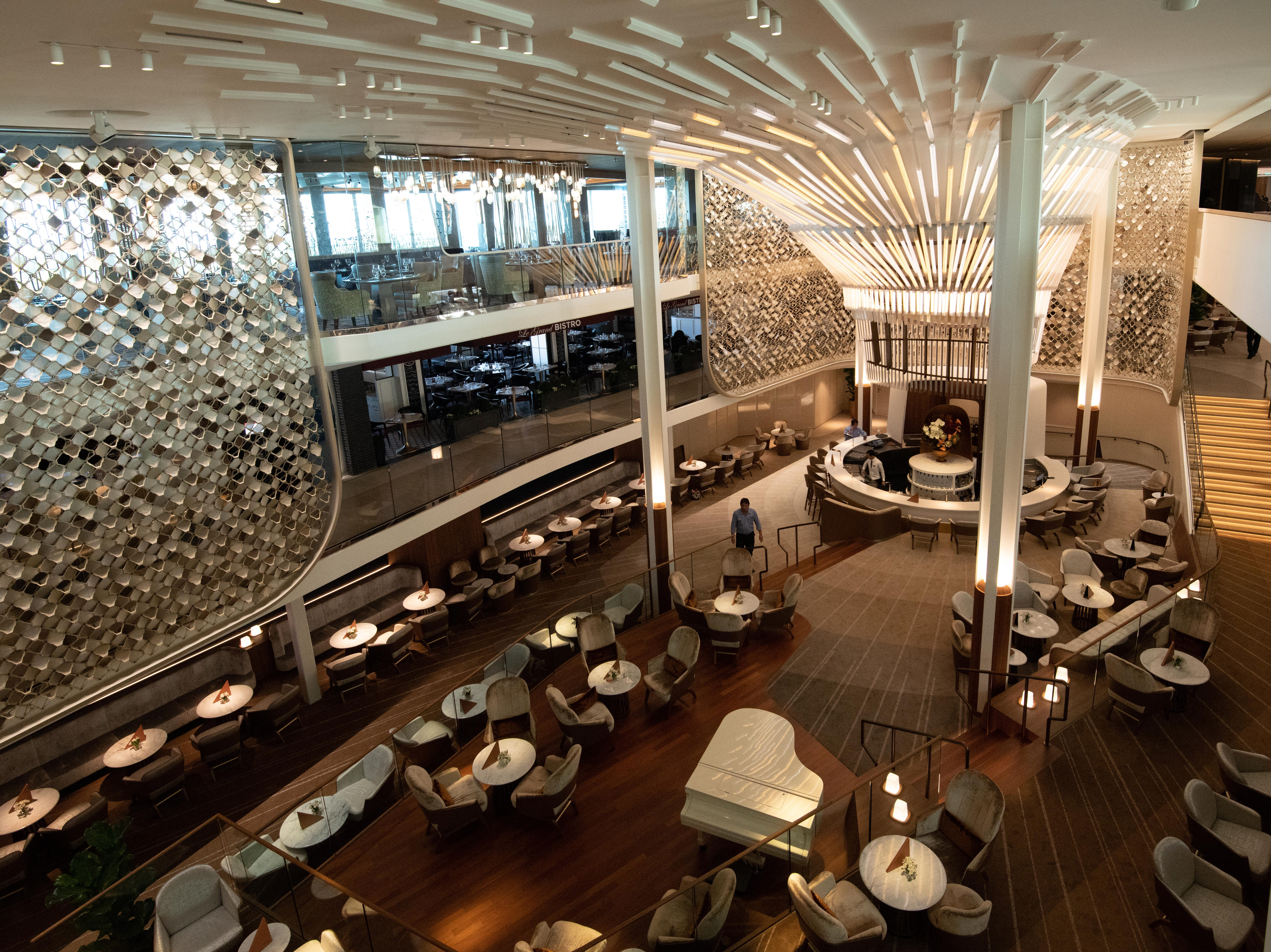The focal point of The Grand Plaza is The Chandelier, a striking light feature and art piece that soars above the ship's signature Martini Bar