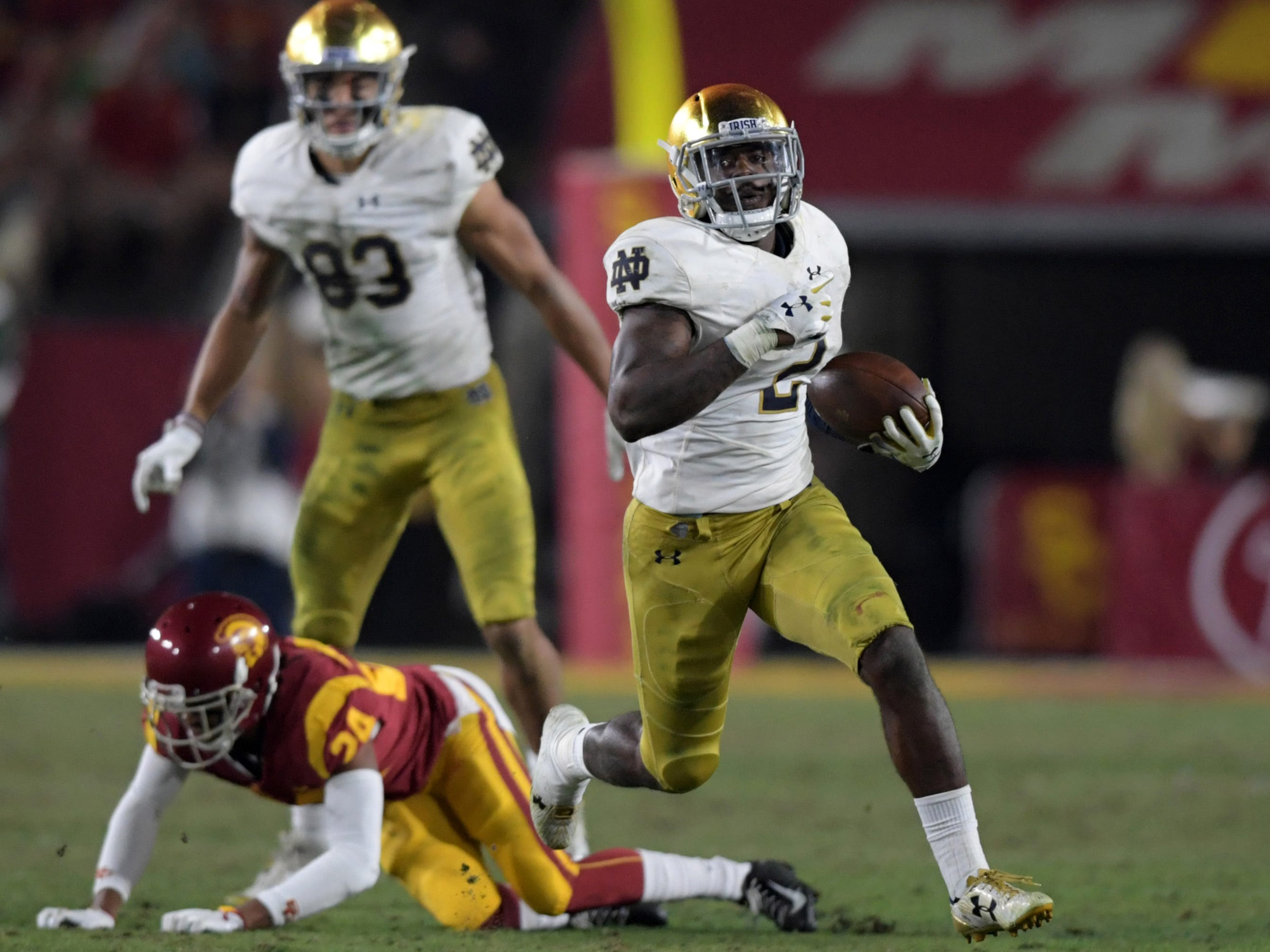 Notre Dame Fighting Irish running back Dexter Williams (2) scores on a 52-yard touchdown run in the third quarter against the Southern California Trojans at Los Angeles Memorial Coliseum.