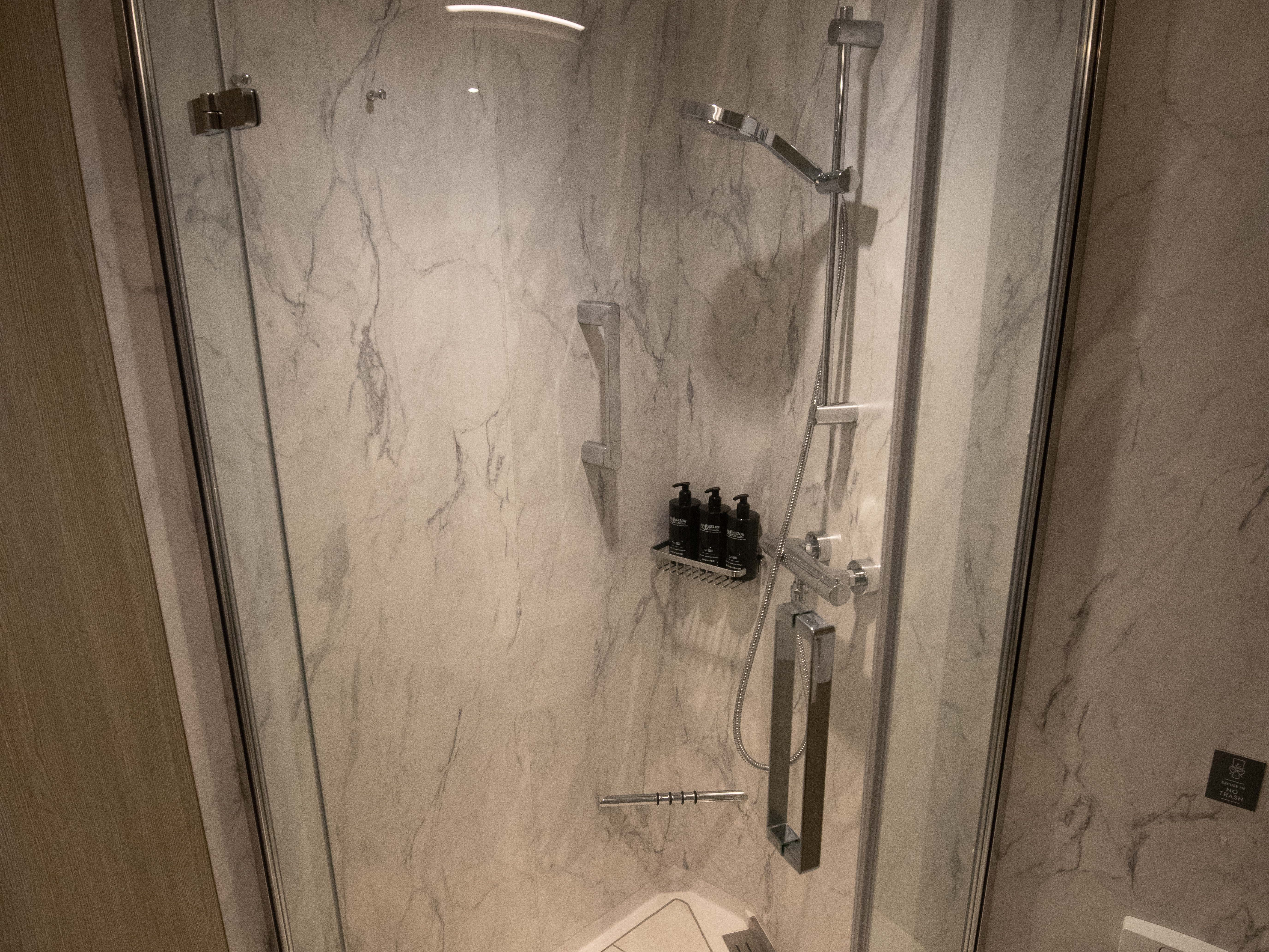 The shower in Edge Stateroom with Infinite Veranda cabin bathrooms.