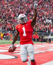 Ohio State receiver Johnnie Dixon celebrates his first-half touchdown.