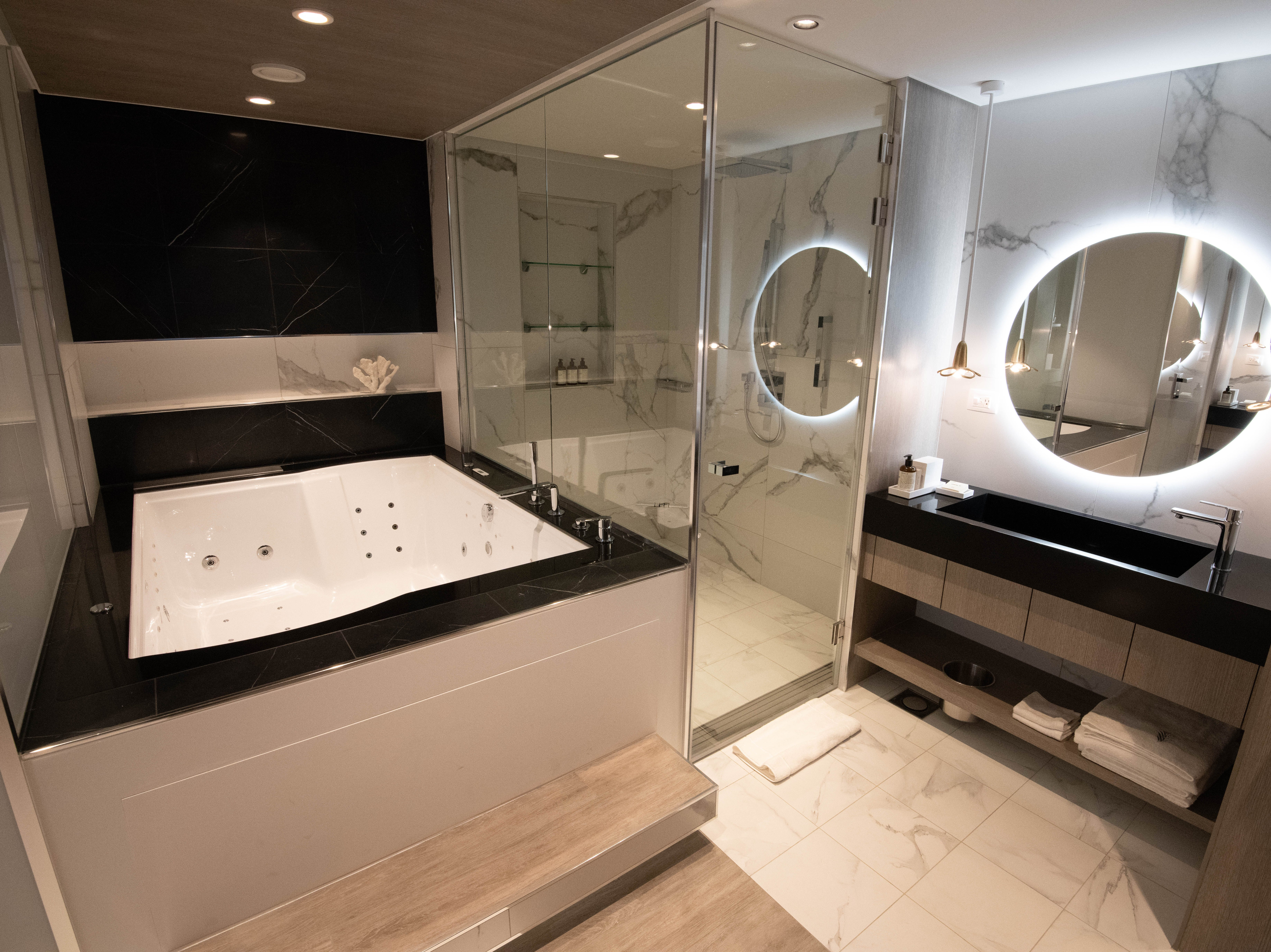 Iconic Suite master bathrooms feature massive whirlpool tubs, marble-lined showers and two sink areas.