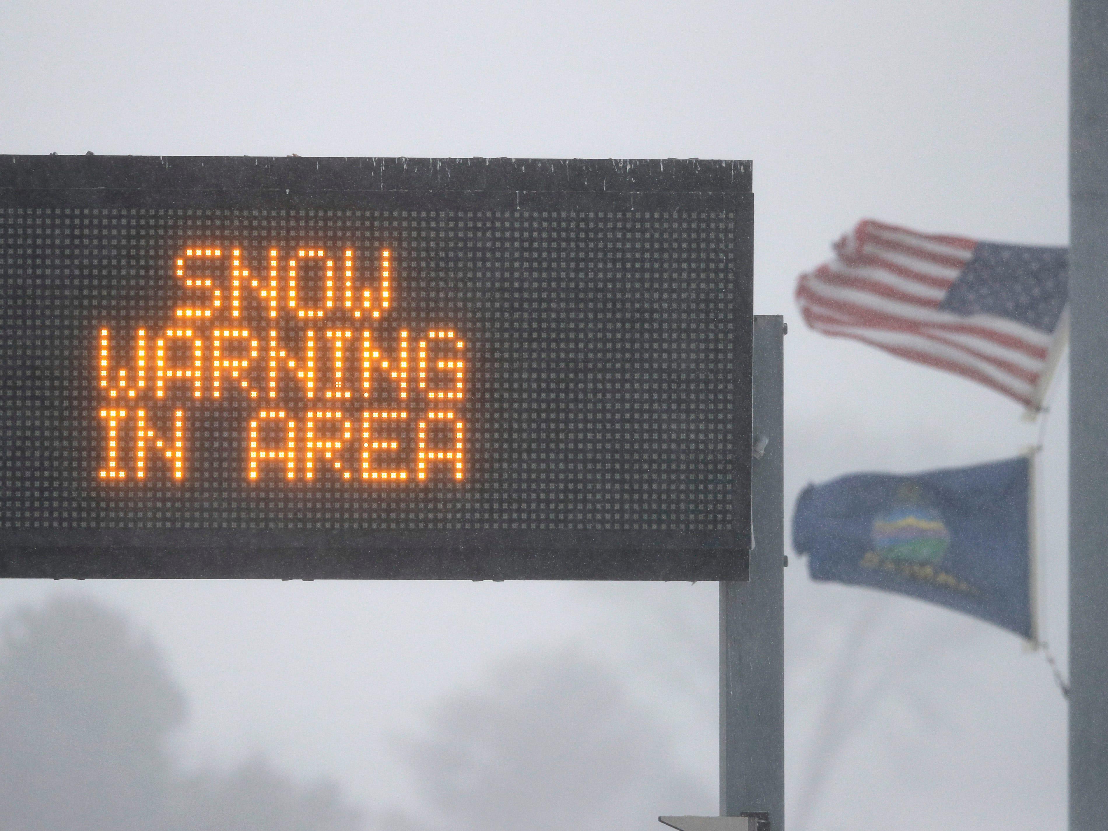 A snow warning sign marks an entrance to the Kansas Turnpike near Lawrence, Kan., Sunday, Nov. 25, 2018.