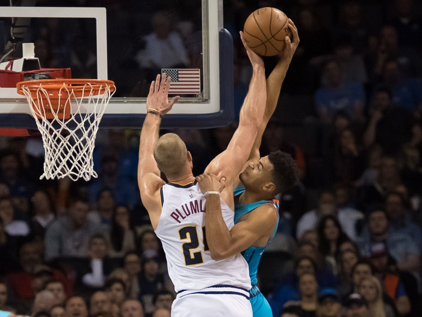Nov. 24: Thunder guard Timothe Luwawu-Cabarrot (7) was ready to throw it down, but Nuggets defender Mason Plumlee (24) had other ideas.