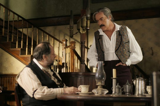 "Ricky Jay, left, opposite Powers Boothe in HBO's ""Deadwood"" in 2003."