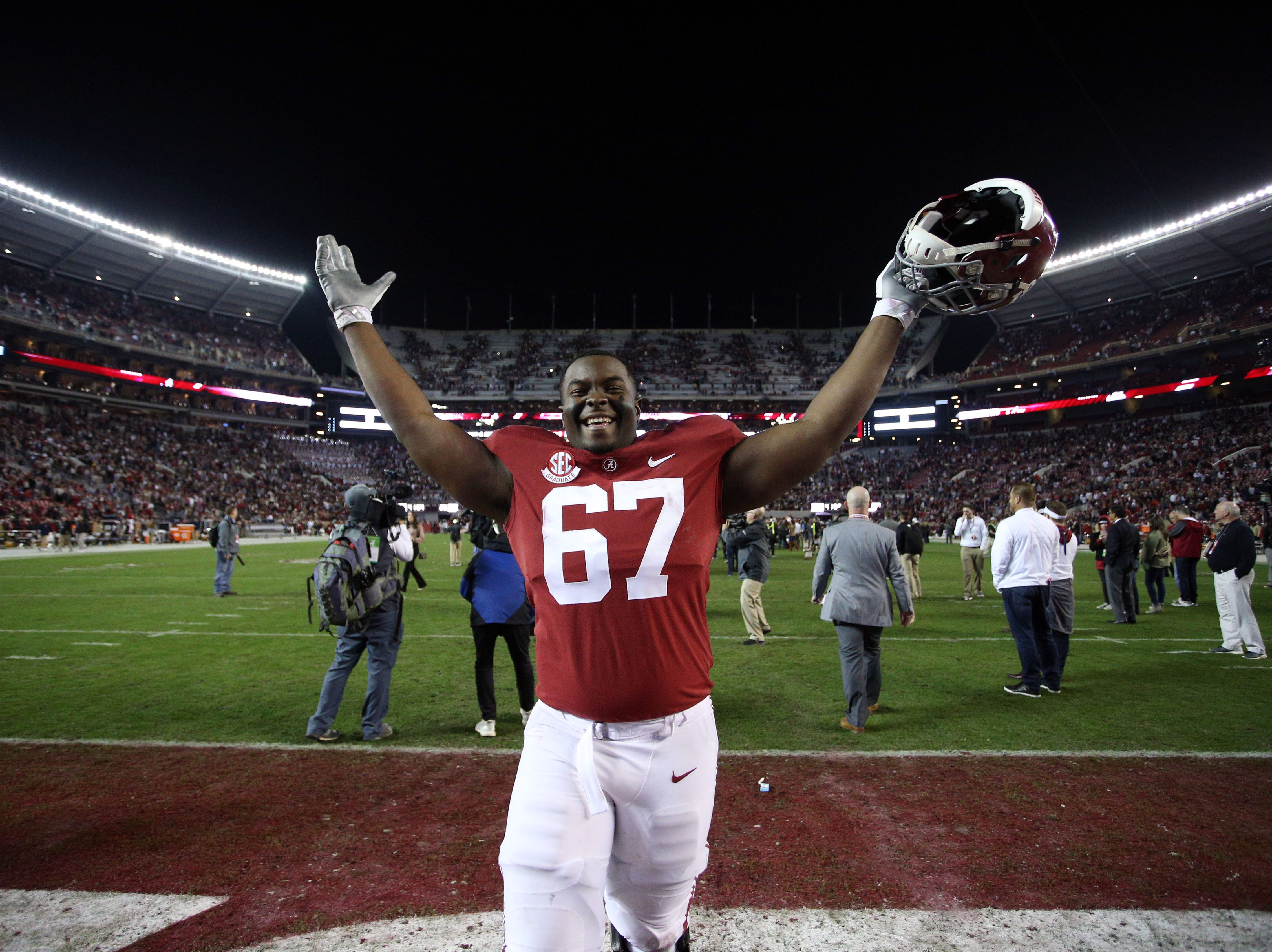 Alabama Crimson Tide offensive lineman Joshua Casher celebrates after defeating the Auburn Tigers at Bryant-Denny Stadium.