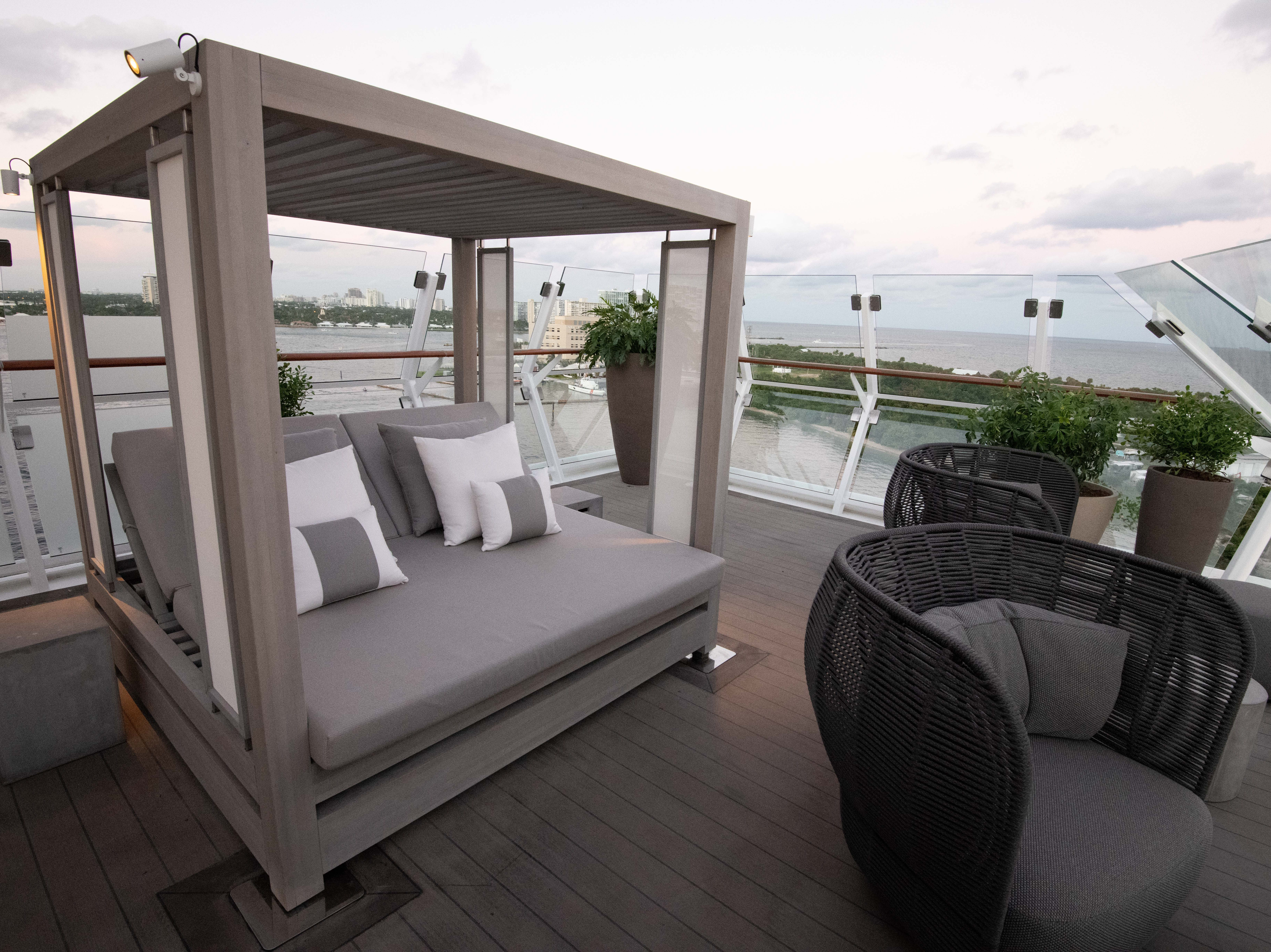 Day beds facing the sea are among the allures of the private balcony areas that come with Iconic Suites.