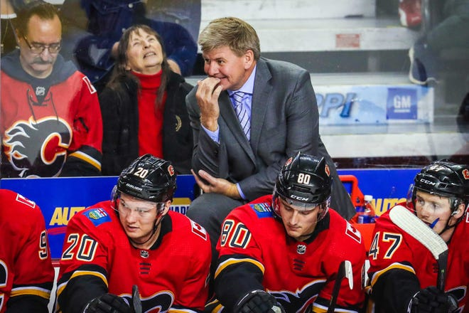 Calgary Flames head coach Bill Peters on his bench during the third period against the San Jose Sharks at Scotiabank Saddledome.
