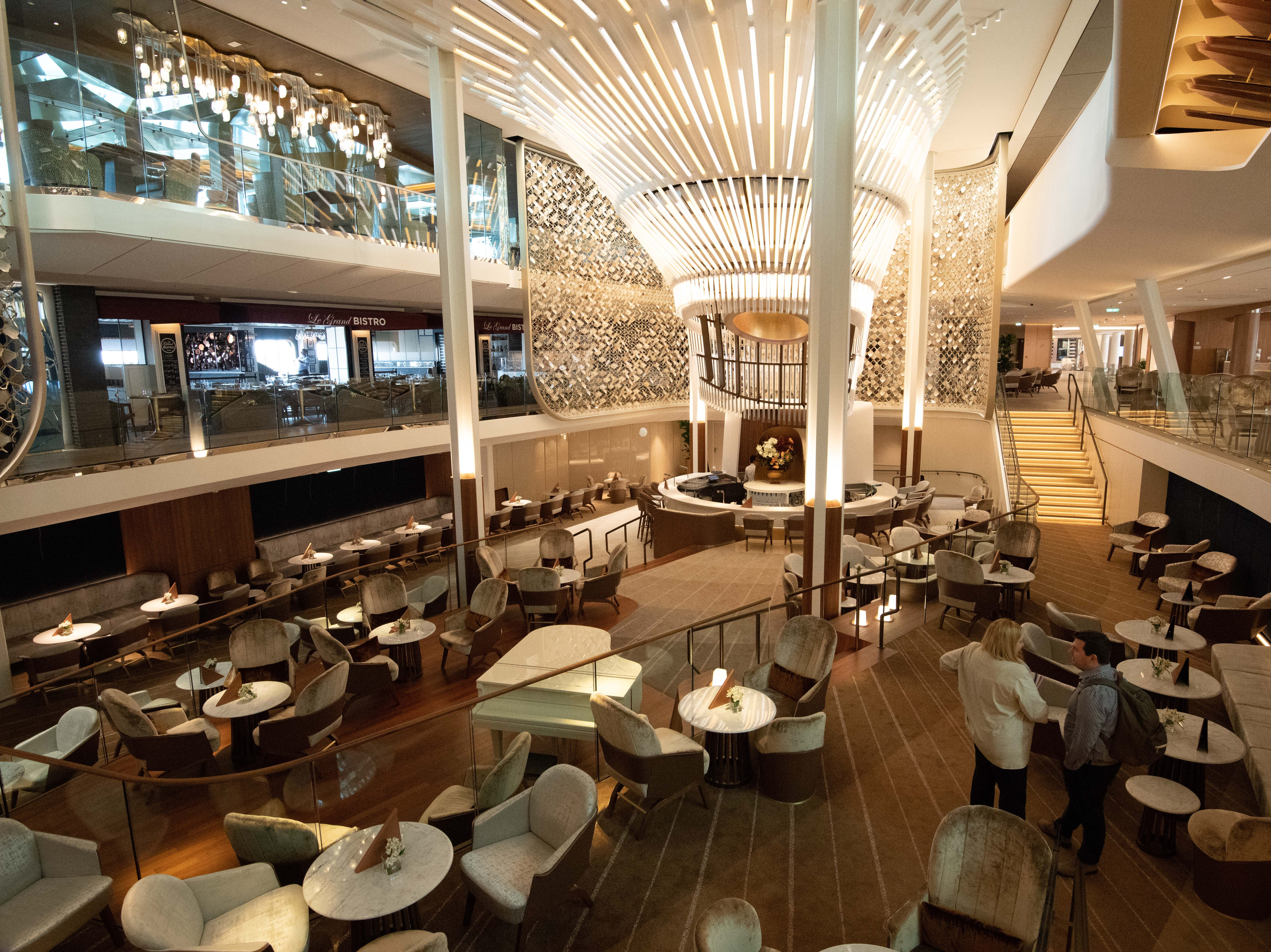 The design of The Grand Plaza on Celebrity Edge was inspired by the era of trans-Atlantic ship travel when dramatic staircases and ornate chandeliers were common on vessels.