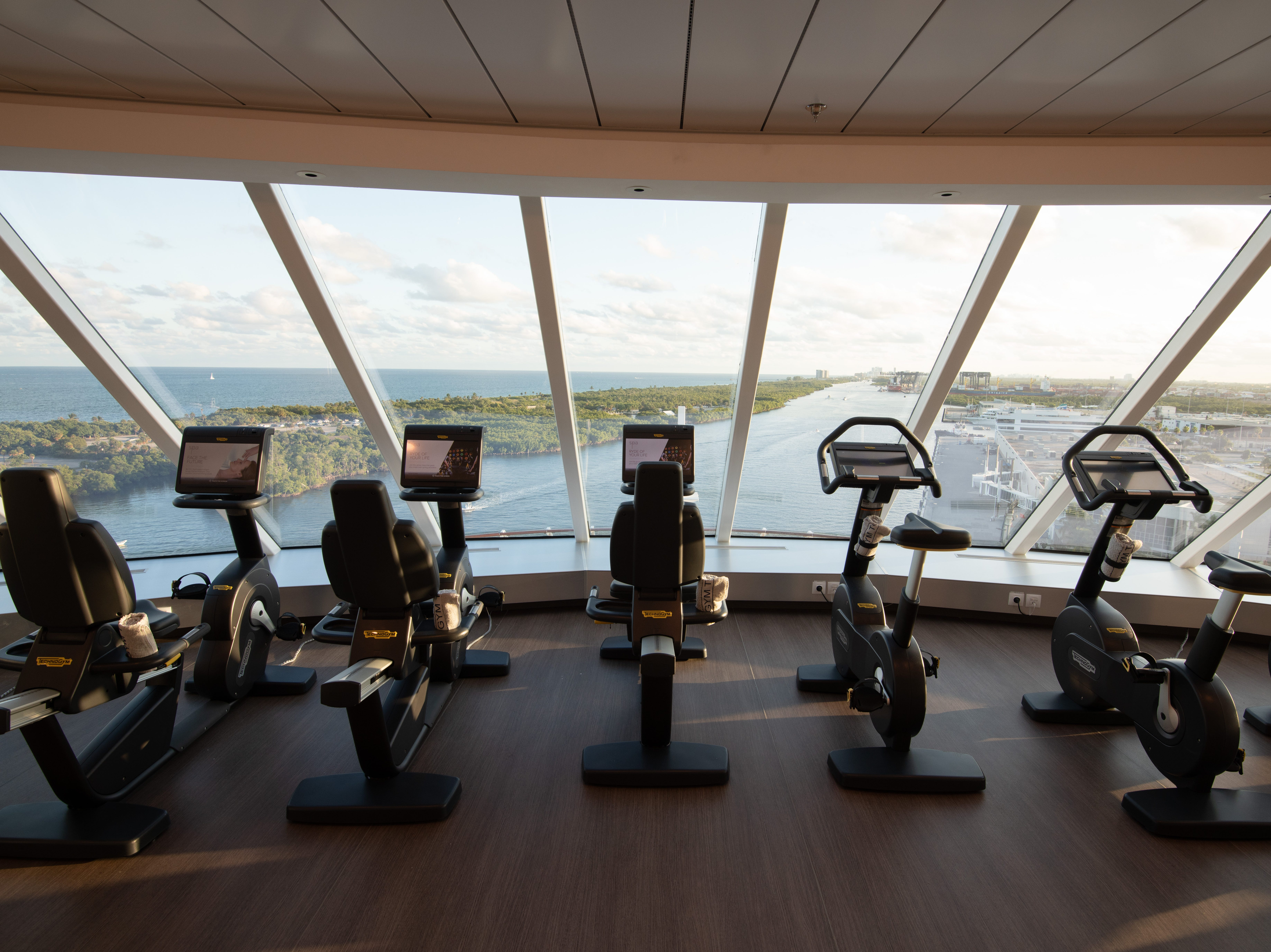 Located on Deck 15, Celebrity Edge's Fitness Center features floor-to-ceiling windows overlooking the front of the vessel.