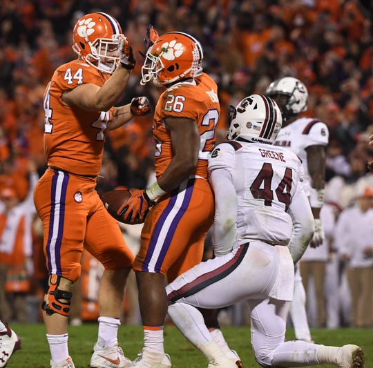 Clemson running back Adam Choice (26) celebrates a touchdown with tight end Garrett Williams (44) near South Carolina defender Sherrod Greene during the second quarter in Memorial Stadium during Saturday's victory, the 100th of the decade for the Tigers.