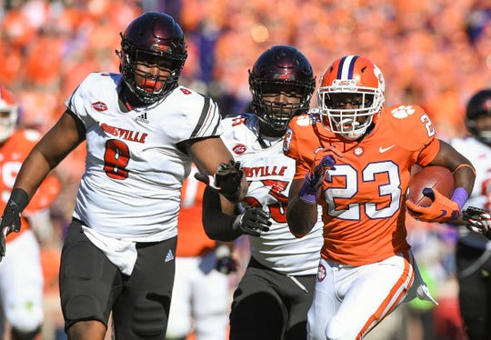 Clemson running back Lyn-J Dixon (23) breaks free to score against Louisville. The Tigers won their eight ACC games by an average of five touchdowns in 2018.