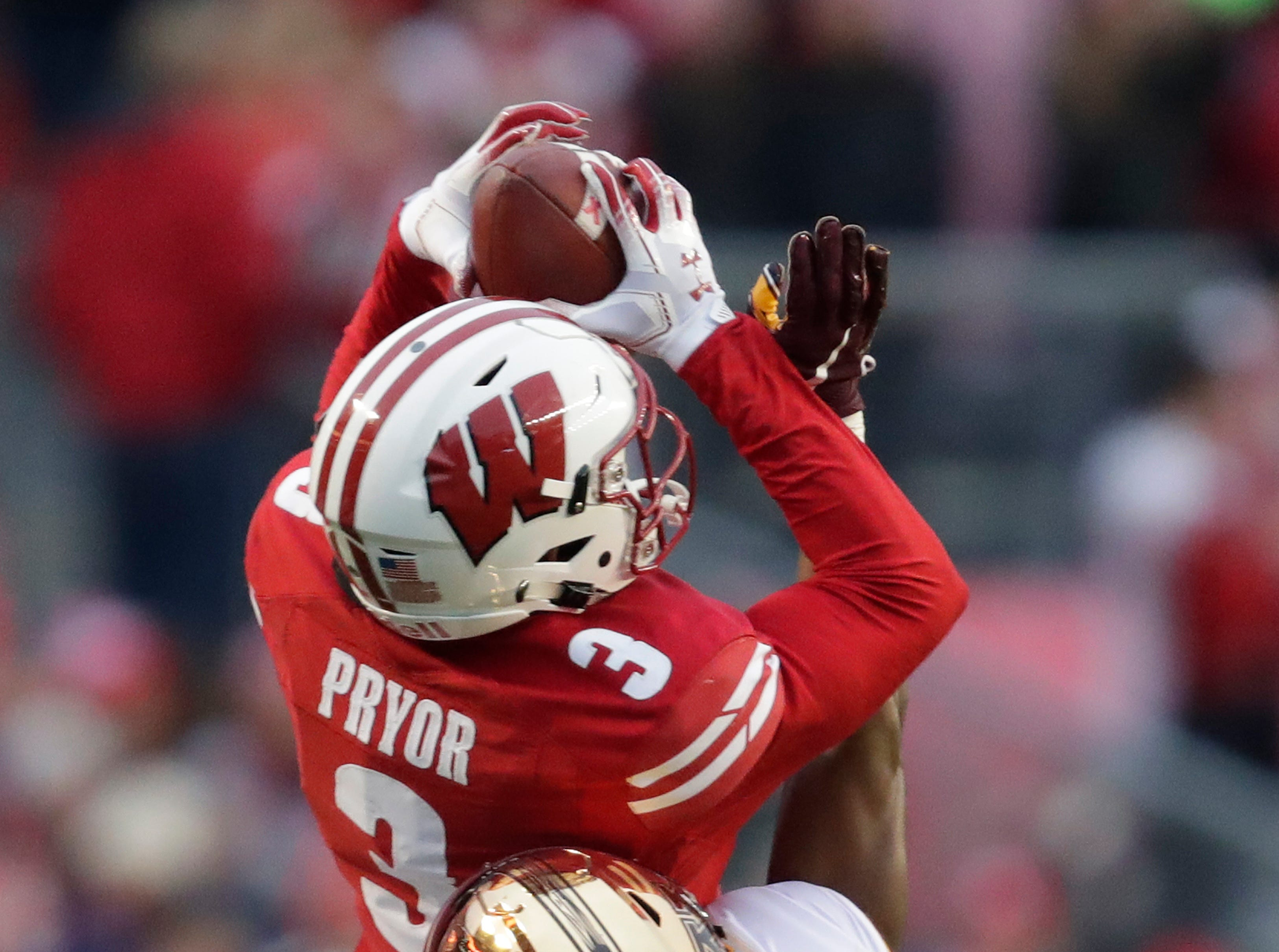 Wisconsin wide receiver Kendric Pryor (3) pulls down a long reception against Minnesota defensive back Kiondre Thomas (31) at the end of the first quarter Saturday, November 24, 2018, at Camp Randall Stadium in Madison, Wis. Dan Powers/USA TODAY NETWORK-Wisconsin