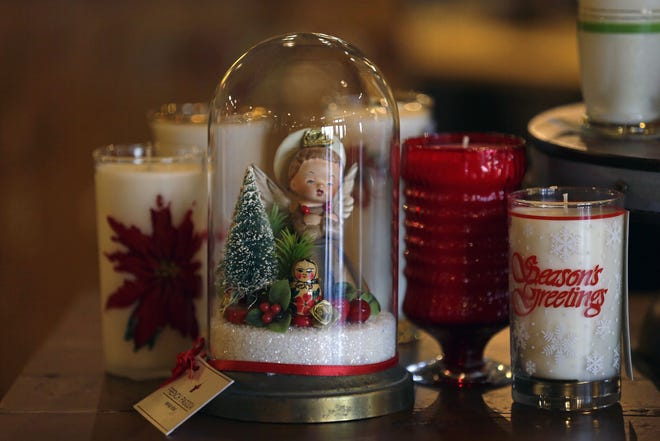 Urban Evolutions in Grand Chute stocks locally made gifts that incorporate reclaimed and vintage materials. Shown here: domed vignette of vintage holiday decorations by French Pagoda of Appleton and scented candles in vintage glasses by Appleton's Ann Rausch.