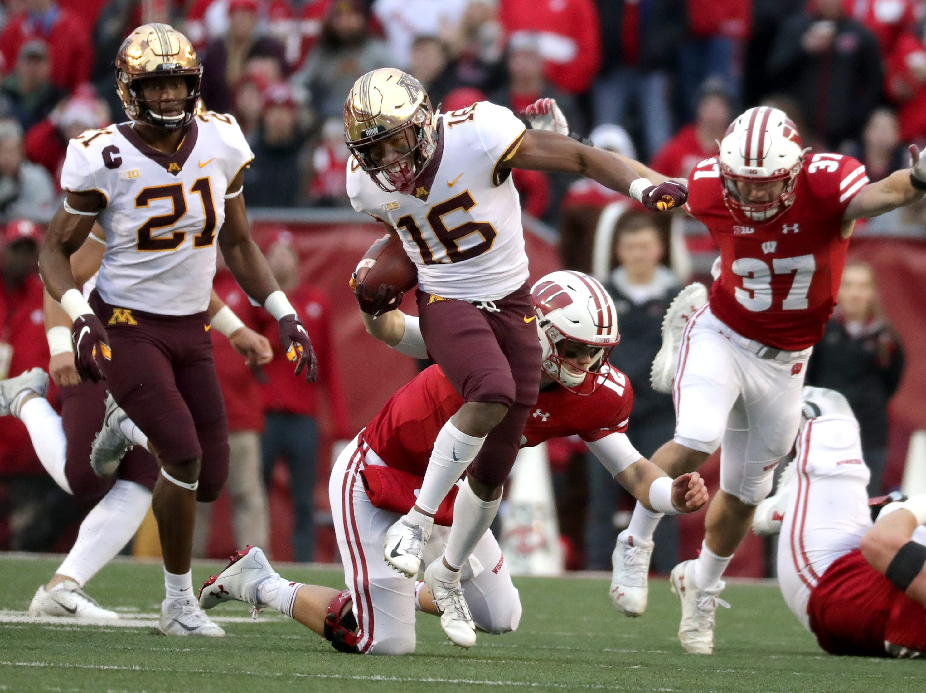 Wisconsin quarterback Alex Hornibrook tries to tackle Minnesota defensive back Coney Durr after throwing an first half interception during their NCAA football game on Saturday, November 24, 2018, at Camp Randall in Madison, Wis.Wm. Glasheen/USA TODAY NETWORK-Wisconsin.