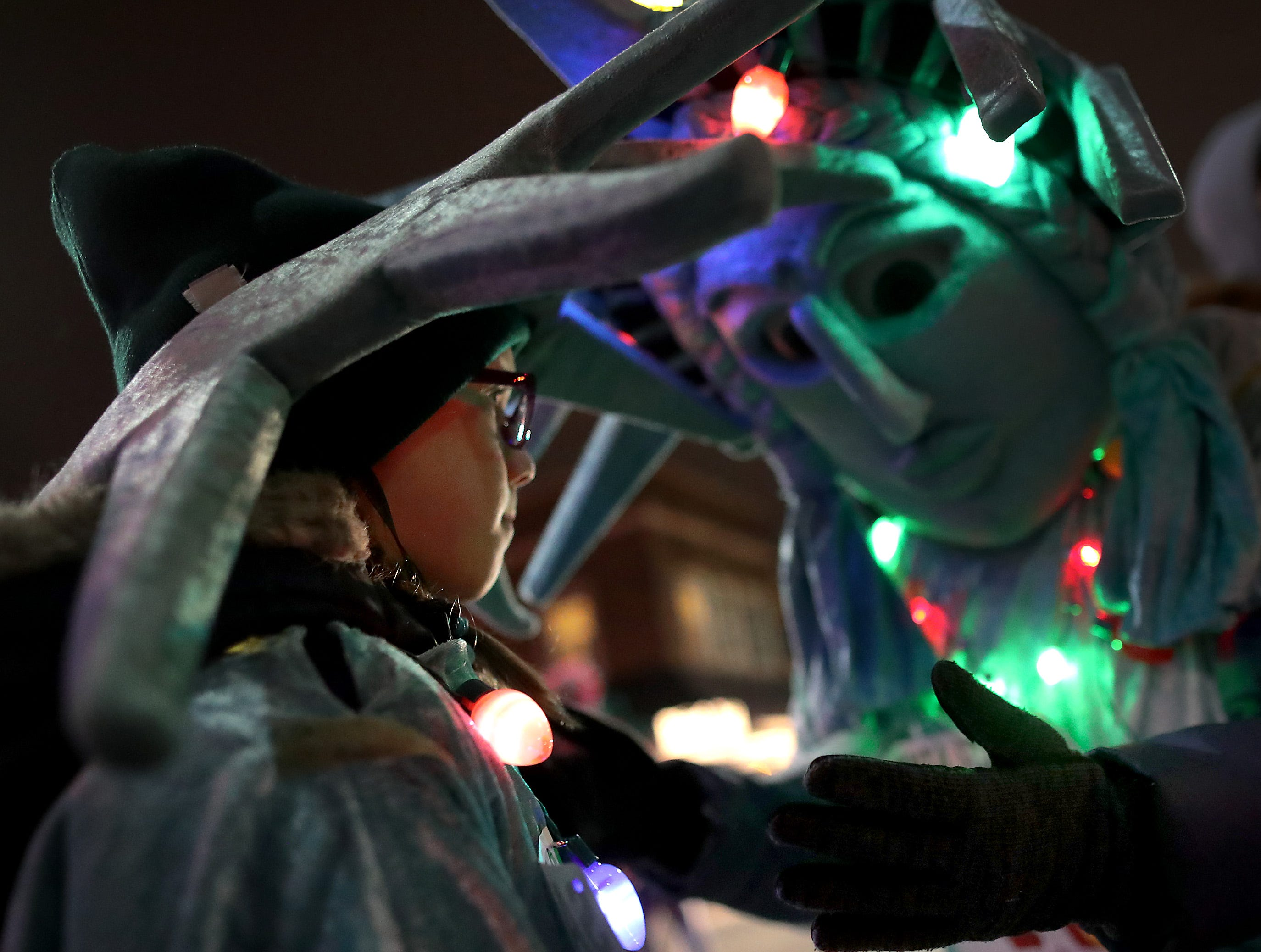 """Yoly Anderson, right, and her daughter Eva, both dressed as Lady Liberty, prepare to run the Santa Scamper before the 48th Annual Downtown Appleton Christmas Parade on Tuesday, Nov. 20, 2018 in Appleton, Wis. This year's theme was """"Home for the Holidays."""" Wm. Glasheen/USA TODAY NETWORK-Wisconsin."""