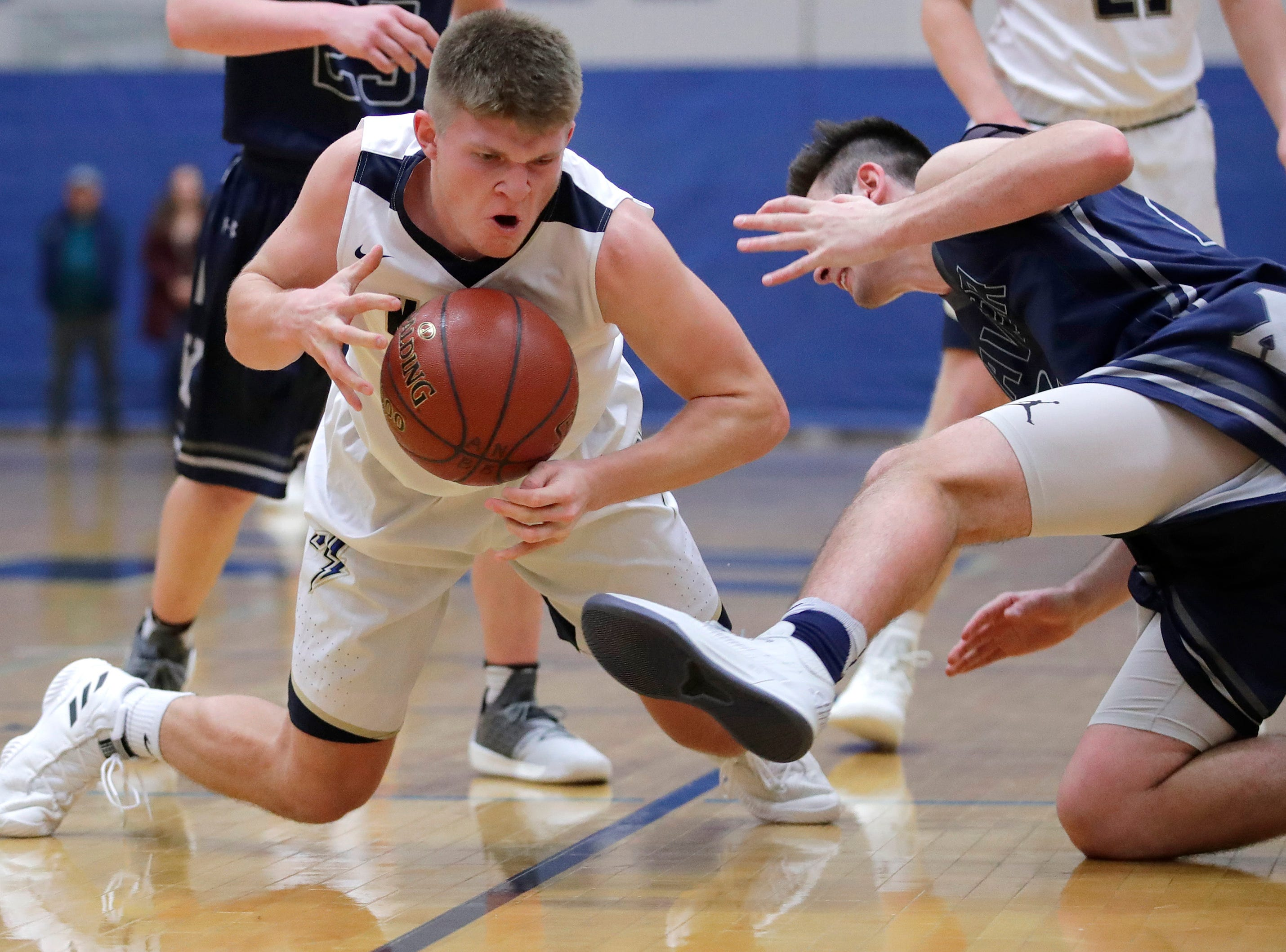 Appleton North High School's Devin Blom falls on a ball during their game against Xavier High School Wednesday, Nov. 21, 2018, in Appleton, Wis.Danny Damiani/USA TODAY NETWORK-Wisconsin