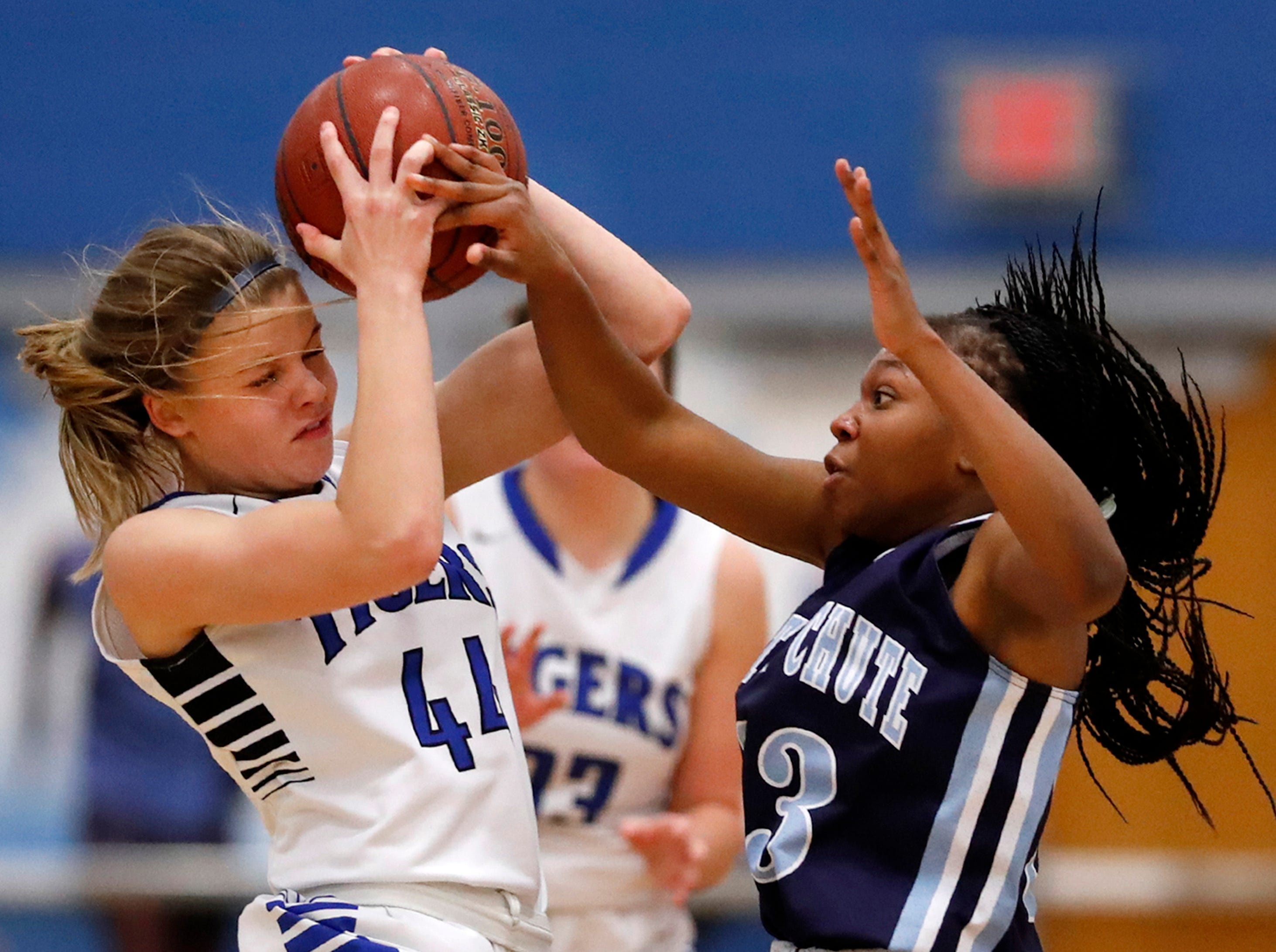 Wrightstown High School's Ella Diny tries to keep control of the ball while being covered by Little Chute High School's Alyssa Hutcherson Tuesday, Nov. 20, 2018, in Wrightstown, Wis. Wrightstown High School defeated Little Chute High School 73-56.Danny Damiani/USA TODAY NETWORK-Wisconsin