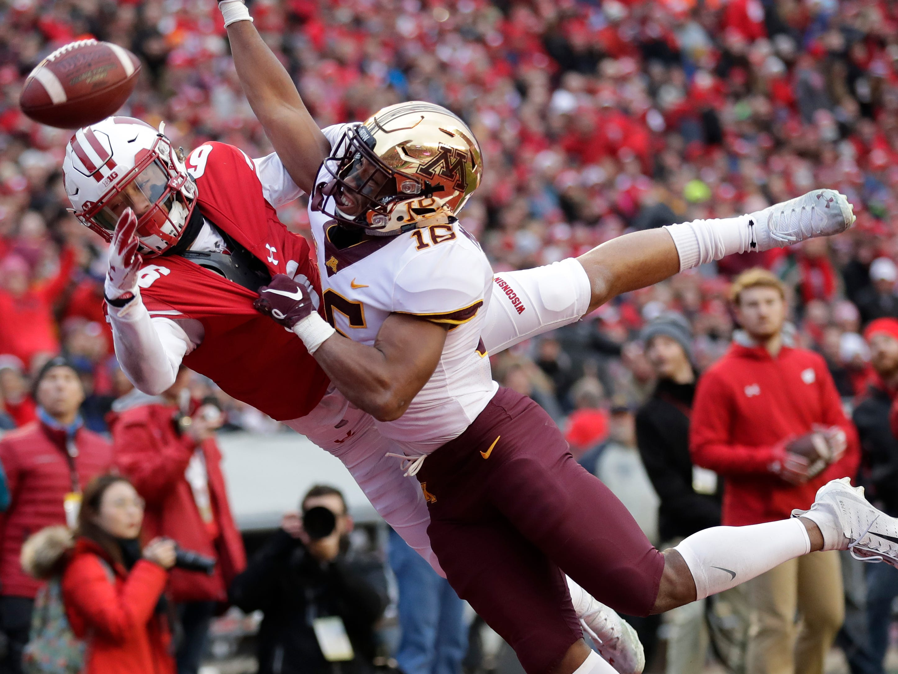 Minnesota defensive back Coney Durr (16) breaks up a pass in the endzone intended for Wisconsin wide receiver Danny Davis III (6) during the first quarter Saturday, November 24, 2018, at Camp Randall Stadium in Madison, Wis. Dan Powers/USA TODAY NETWORK-Wisconsin
