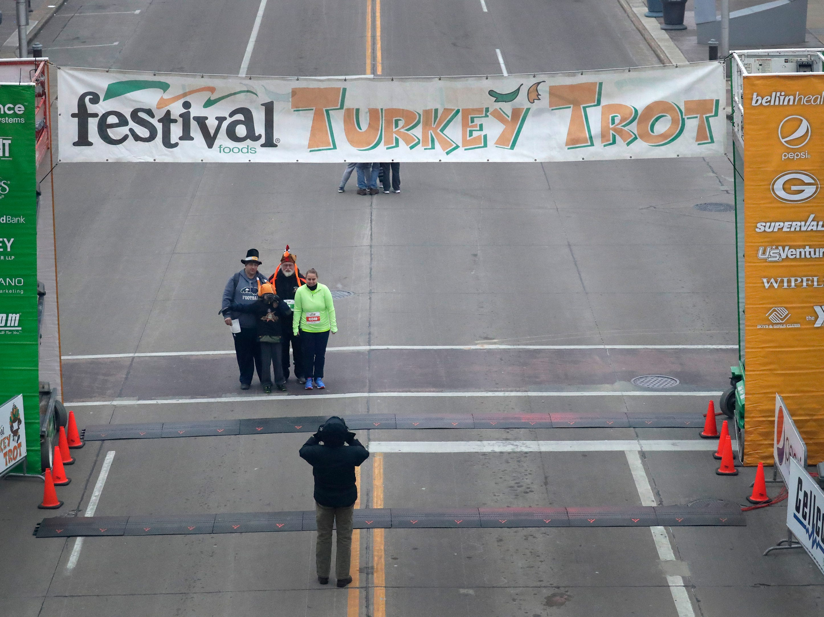 Members of the Brien, Bourassa and Kramer familes pose for a photo at the starting line prior to the 11th Annual Festival Foods Turkey Trot Thursday, November 22, 2018, in Appleton, Wis. Dan Powers/USA TODAY NETWORK-Wisconsin