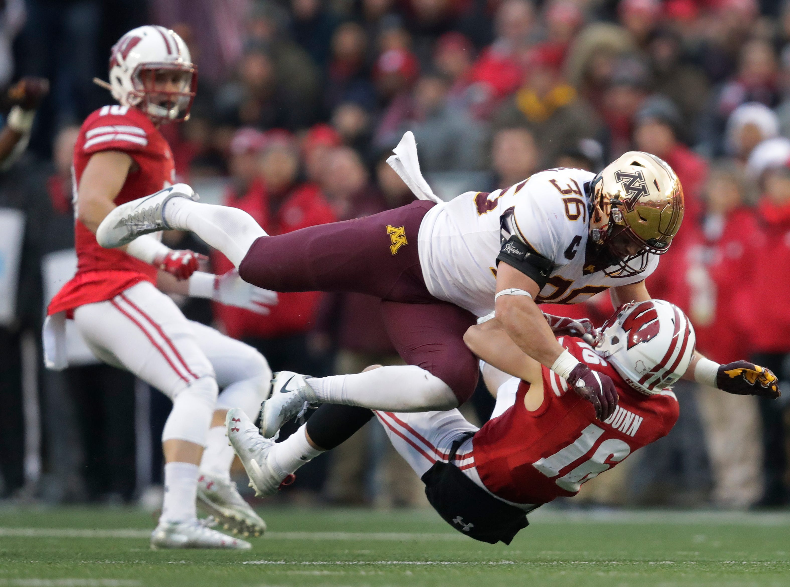 Wisconsin wide receiver Jack Dunn (16) is hit on a punt return by Minnesota linebacker Blake Cashman (36) during the second quarter Saturday, November 24, 2018, at Camp Randall Stadium in Madison, Wis. Cashman was penalized for targeting and was ejected from the game.Dan Powers/USA TODAY NETWORK-Wisconsin