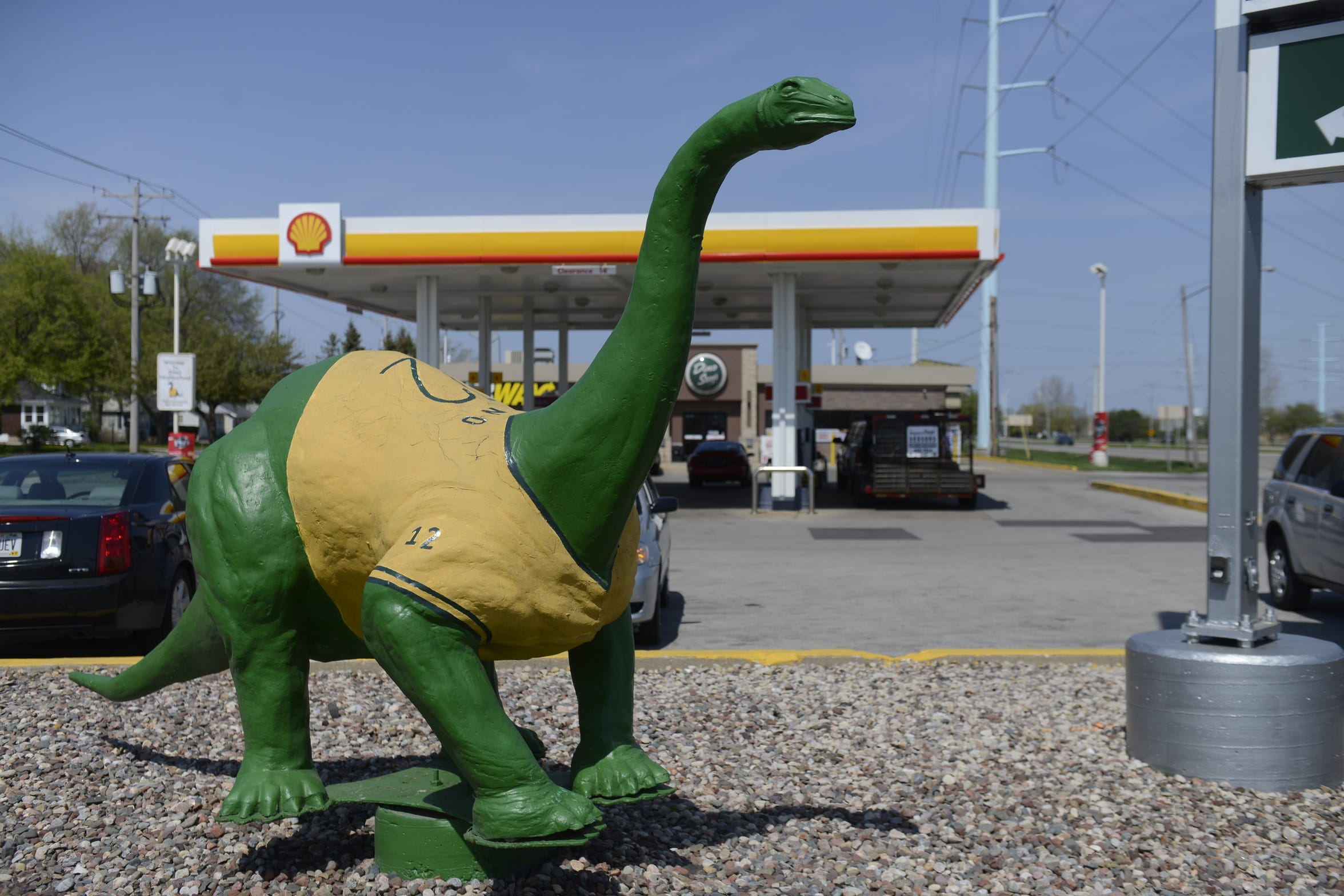The well-known dinosaur at the corner of Lombardi and Ashland avenues in front of a Dino Stop convenience store.