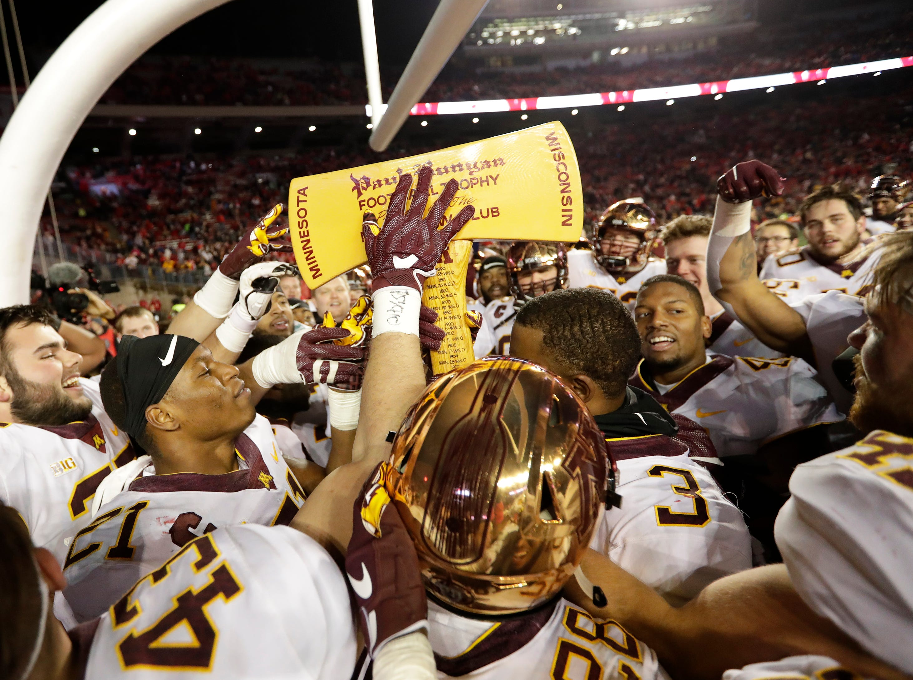 Minnesota players carry Paul Bunyan's Axe after defeating Wisconsin 37-15 Saturday, November 24, 2018, at Camp Randall Stadium in Madison, Wis. Dan Powers/USA TODAY NETWORK-Wisconsin