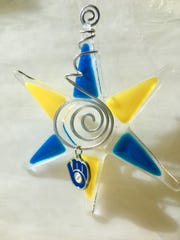 Wild Apple in downtown Menasha makes and sells glass ornaments. Here, one of its ornaments is an homage to the Milwaukee Brewers.