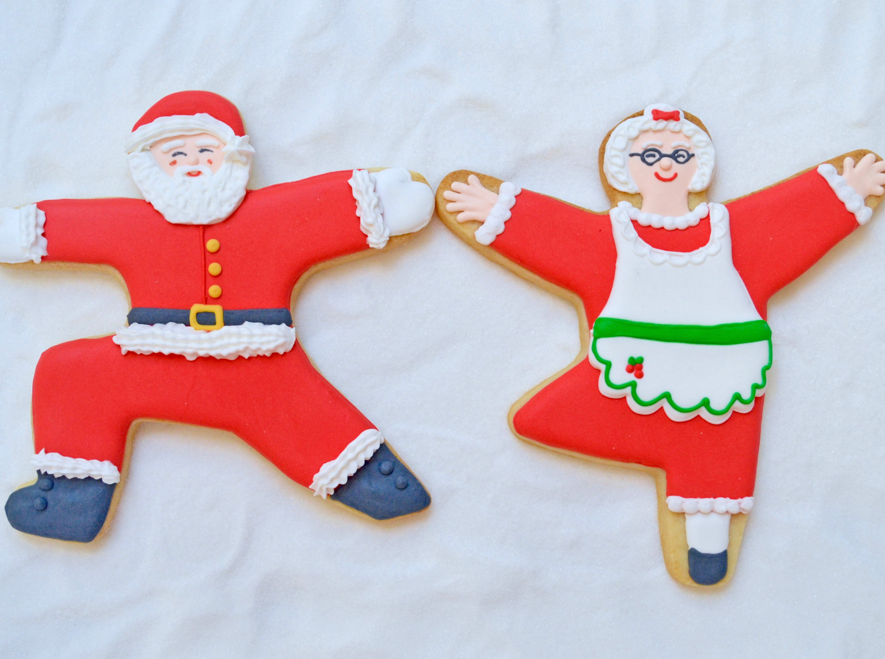 Santa and Mrs. Claus cookies made with yoga pose cookie cutters from Yummi Yogi.