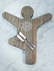 An ash wood yoga cutting and serving board from Yummi Yogi.