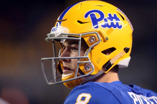 Pittsburgh Panthers quarterback Kenny Pickett (8) looks on from the sidelines against the Virginia Tech Hokies during the third quarter at Heinz Field.